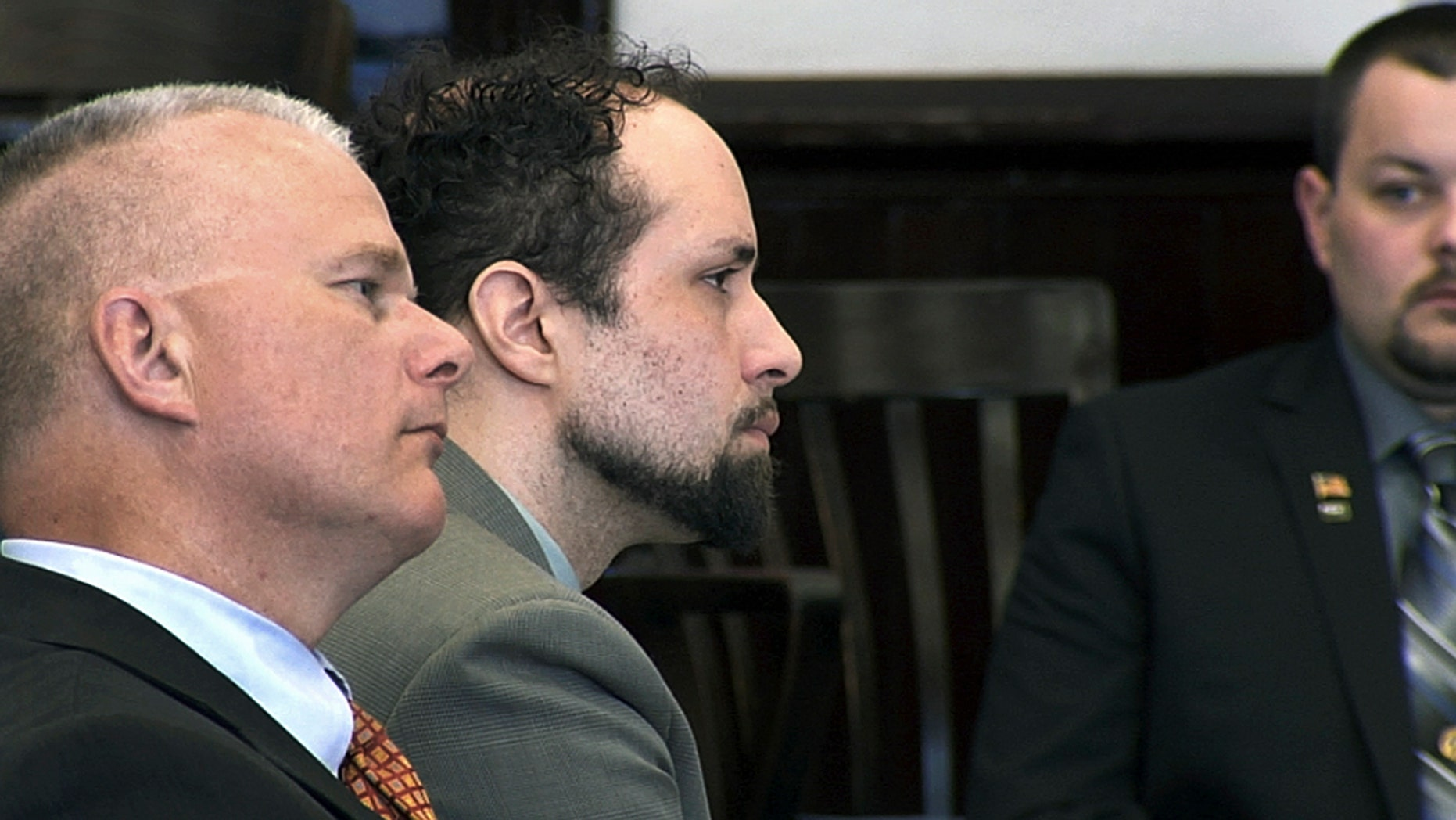 Luc Tieman, center, and his lawyer Stephen Smith, left, listen inside a courtroom where Tieman was sentenced to 55 years, Friday, May 11, 2018, in Somerset County Superior Court in Skowhegan, Maine.