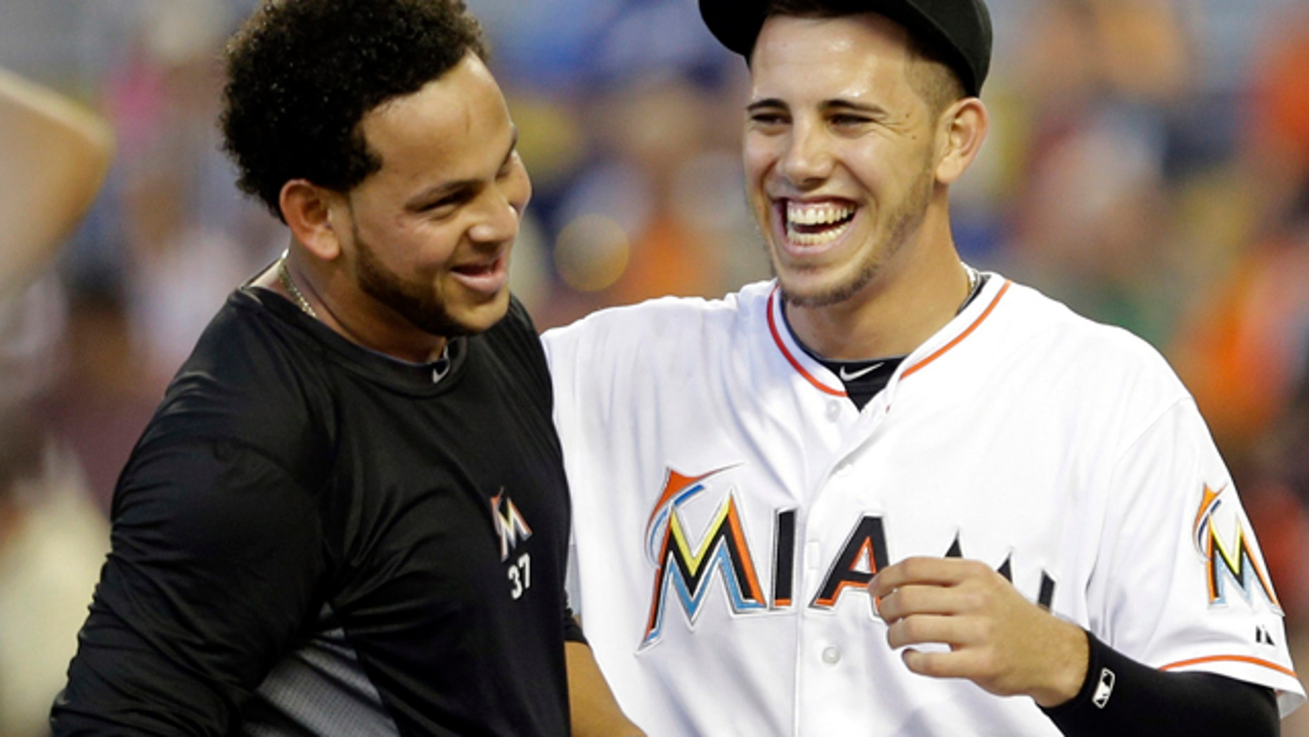 Sept. 29, 2013: Miami Marlins starting pitcher Henderson Alvarez, left, and Jose Fernandez, right, celebrate Alvarez's no-hitter against the Detroit Tigers.