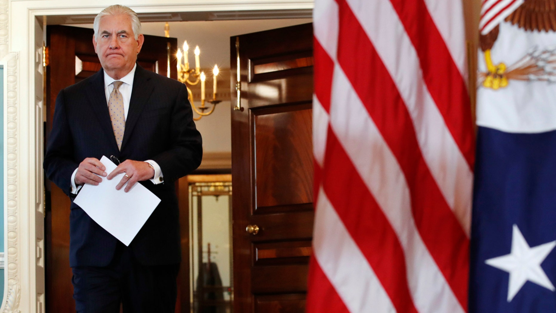 Secretary of State Rex Tillerson walks in to a news conference to speak about Qatar at the State Department in Washington, Friday June 9, 2017. Tillerson is calling on Saudi Arabia, Egypt, the United Arab Emirates and Bahrain to immediately ease their blockade on Qatar.   (AP Photo/Jacquelyn Martin)