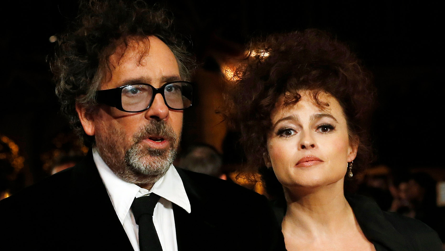 "October 10, 2012. Film director Tim Burton and his wife actress Helena Bonham Carter arrive for the European premiere of his film ""Frankenweenie 3D"" at the Odeon Leicester Square in central London."