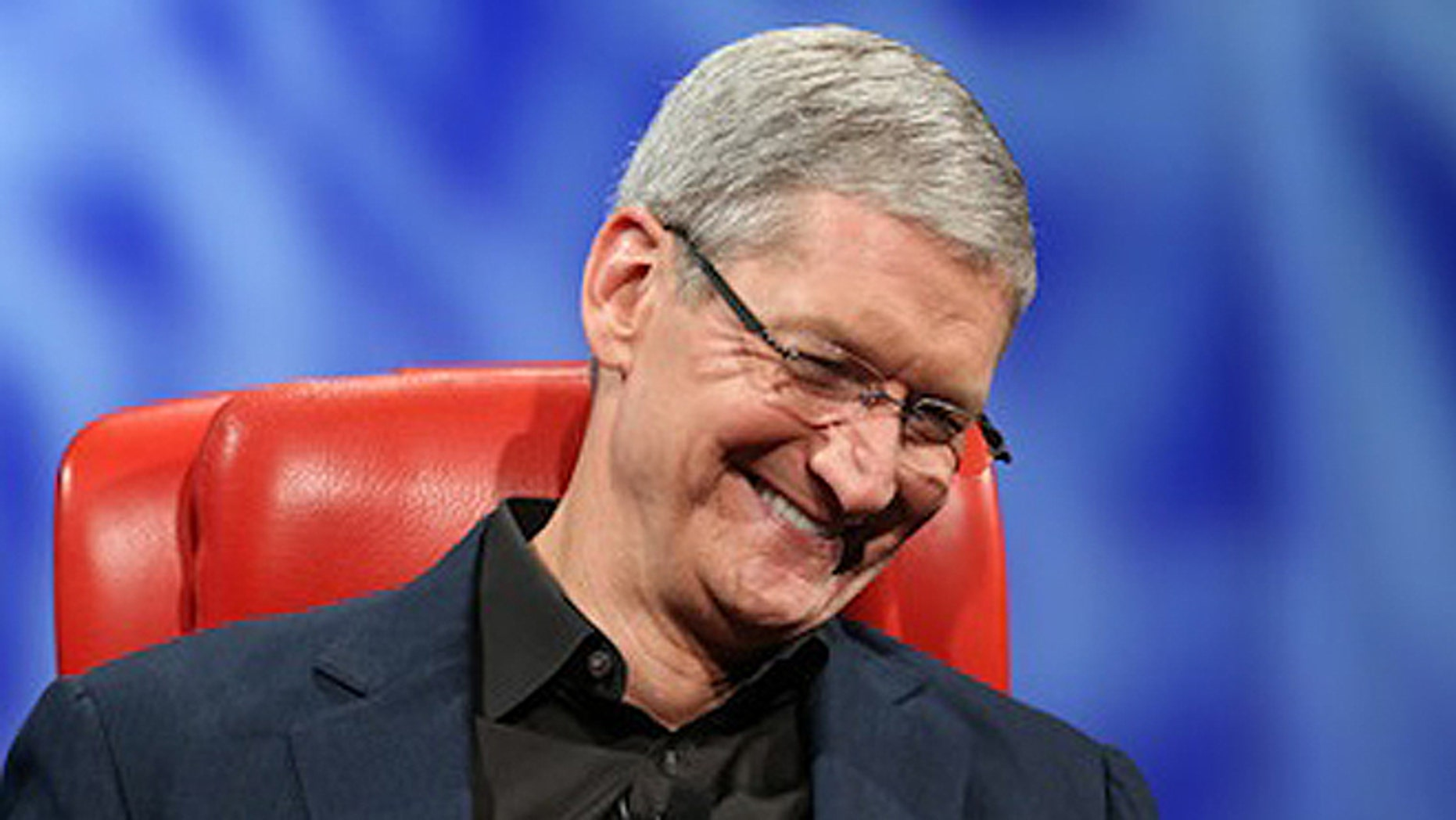 May 28, 2013: Apple CEO Tim Cook laughs on stage at the r 11th D: All Things Digital technology conference in Rancho Palos Verdes, Calif.