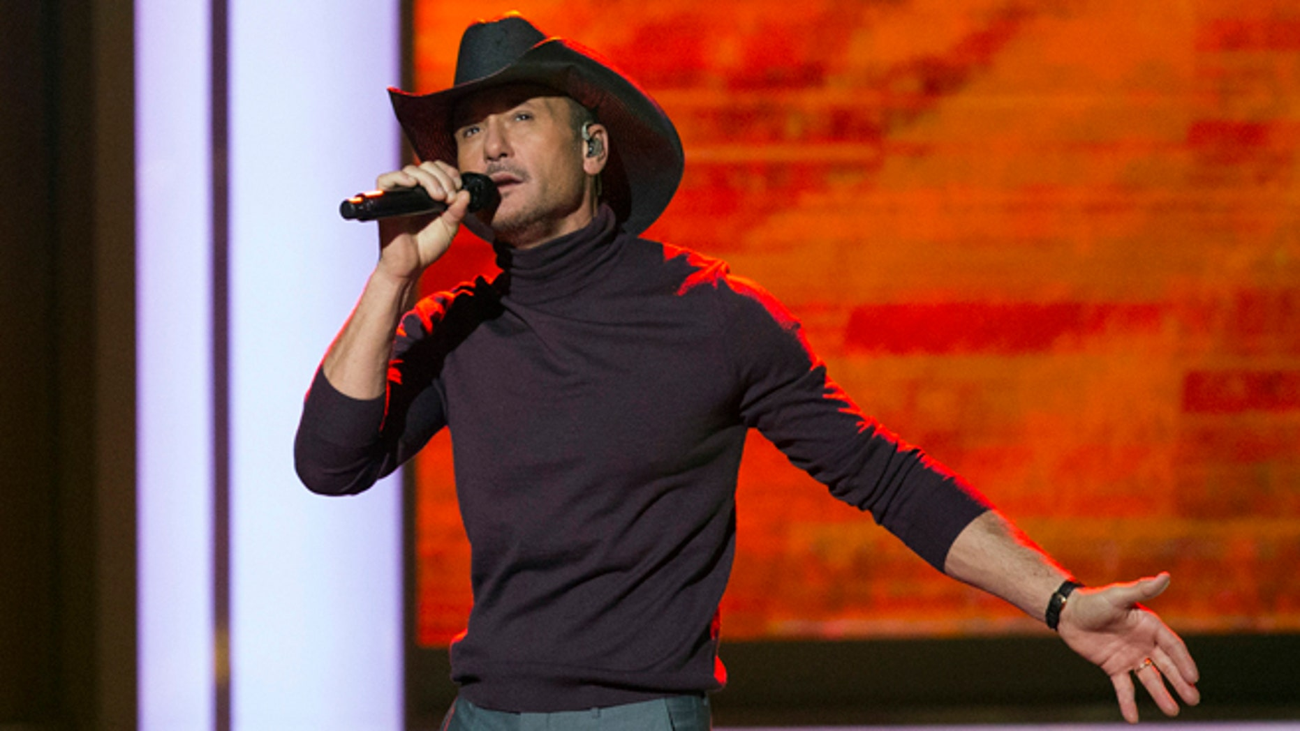 """November 18, 2014. Singer Tim McGraw performs during the taping of  """"A Very GRAMMY Christmas"""" at the Shrine Auditorium in Los Angeles."""
