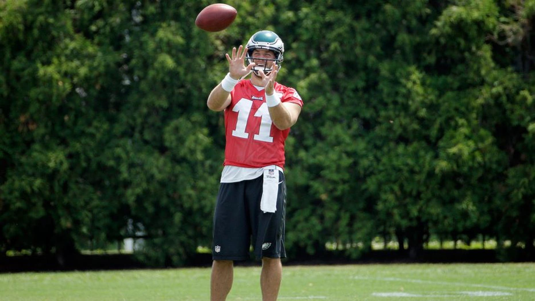 Philadelphia Eagles' Tim Tebow warms up during organized team activities at the NFL football team's practice facility, Thursday, May 28, 2015, in Philadelphia. (AP Photo/Matt Slocum)