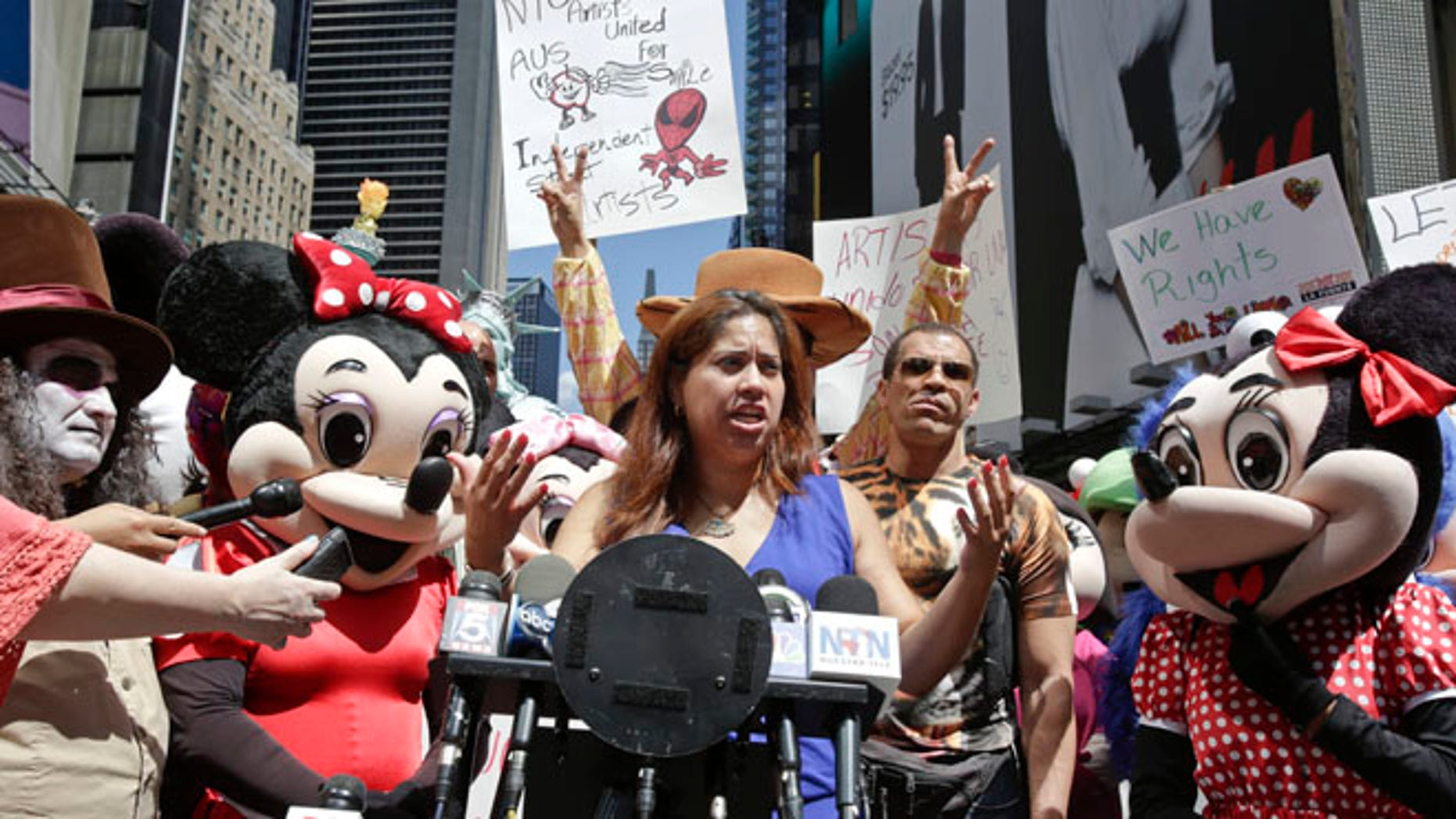 Aug 19, 2014: Lucia Gomez, center, executive director of La Fuente, speaks during a press conference at Times Square in New York.