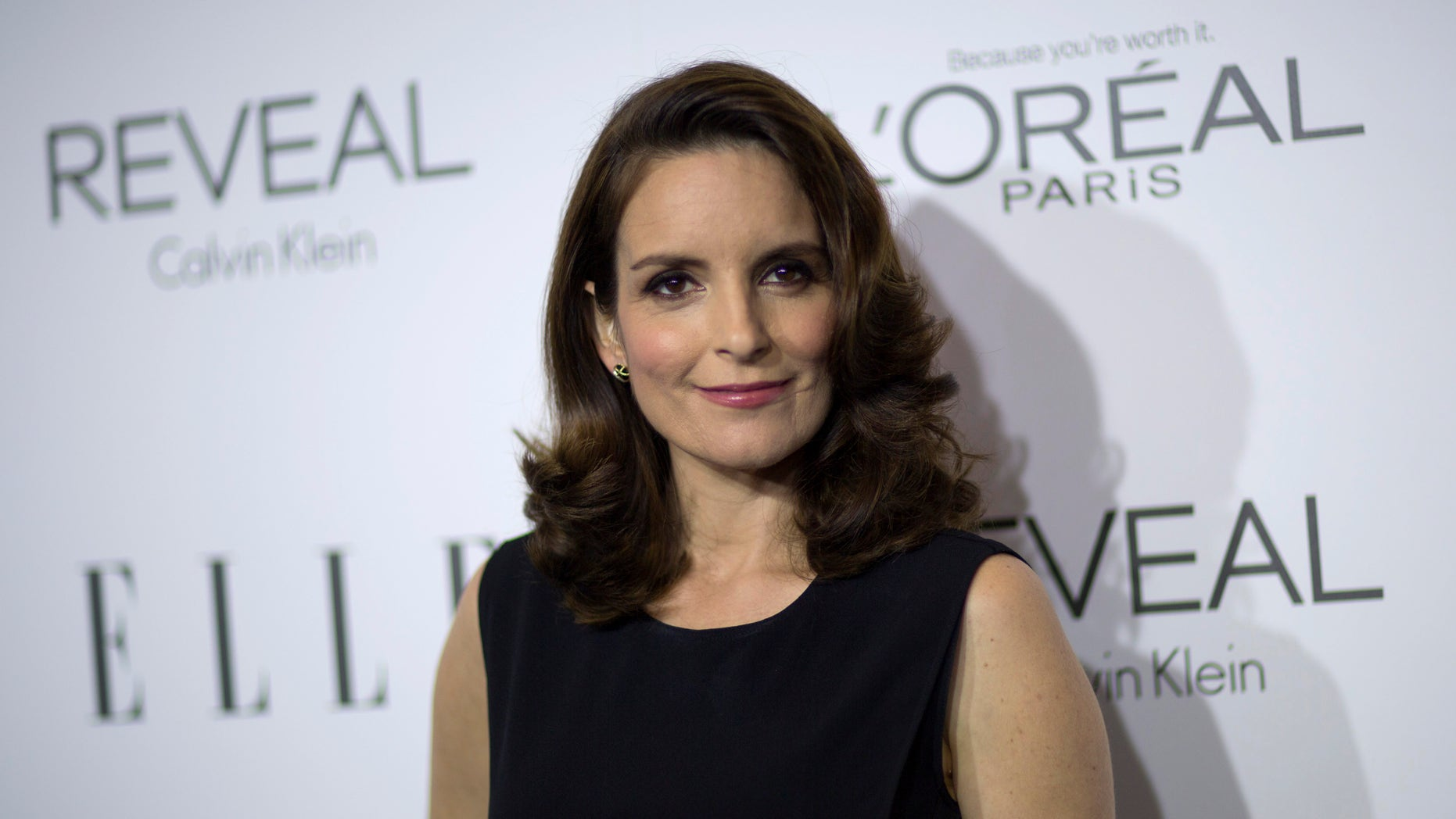 October 20, 2014. Actress and honoree Tina Fey poses at the 21st annual ELLE Women in Hollywood Awards in Los Angeles.