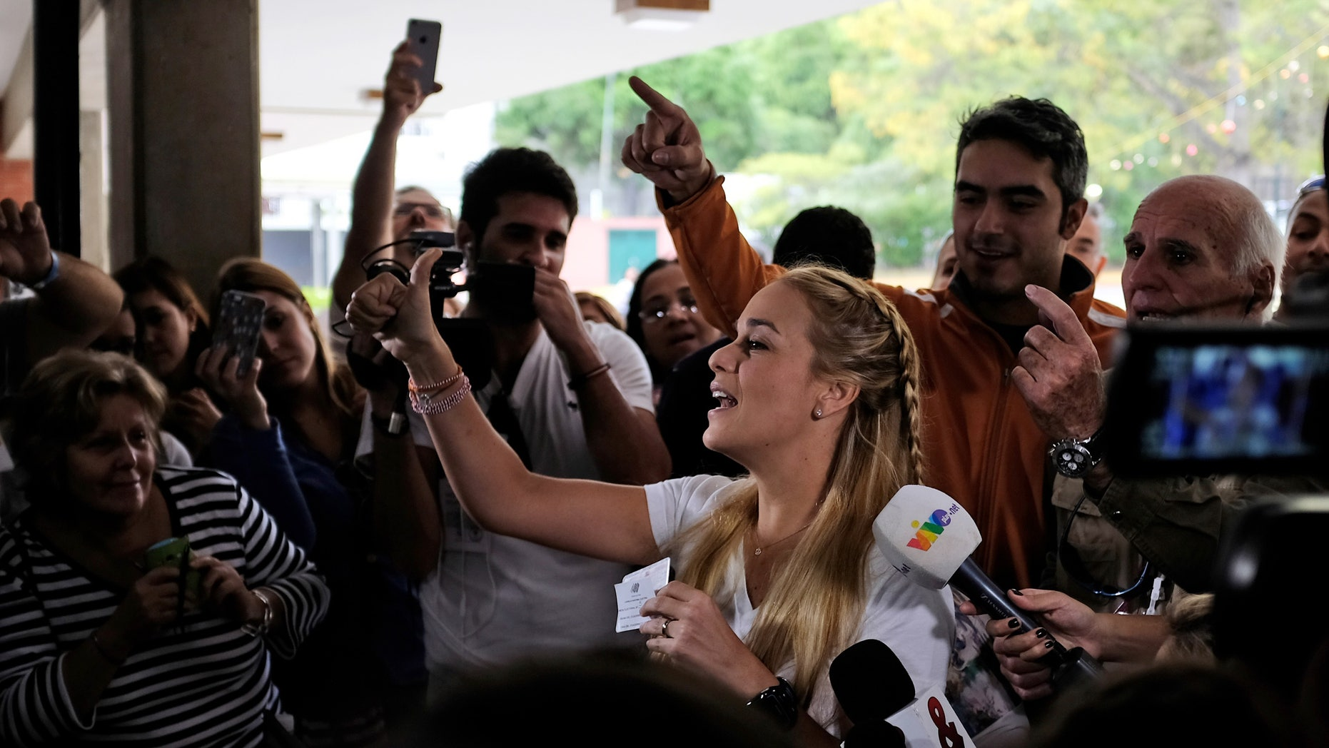 Lilian Tintori, the wife of jailed opposition leader Leopoldo Lopez, arrives to a polling station in Caracas, Dec. 6, 2015.