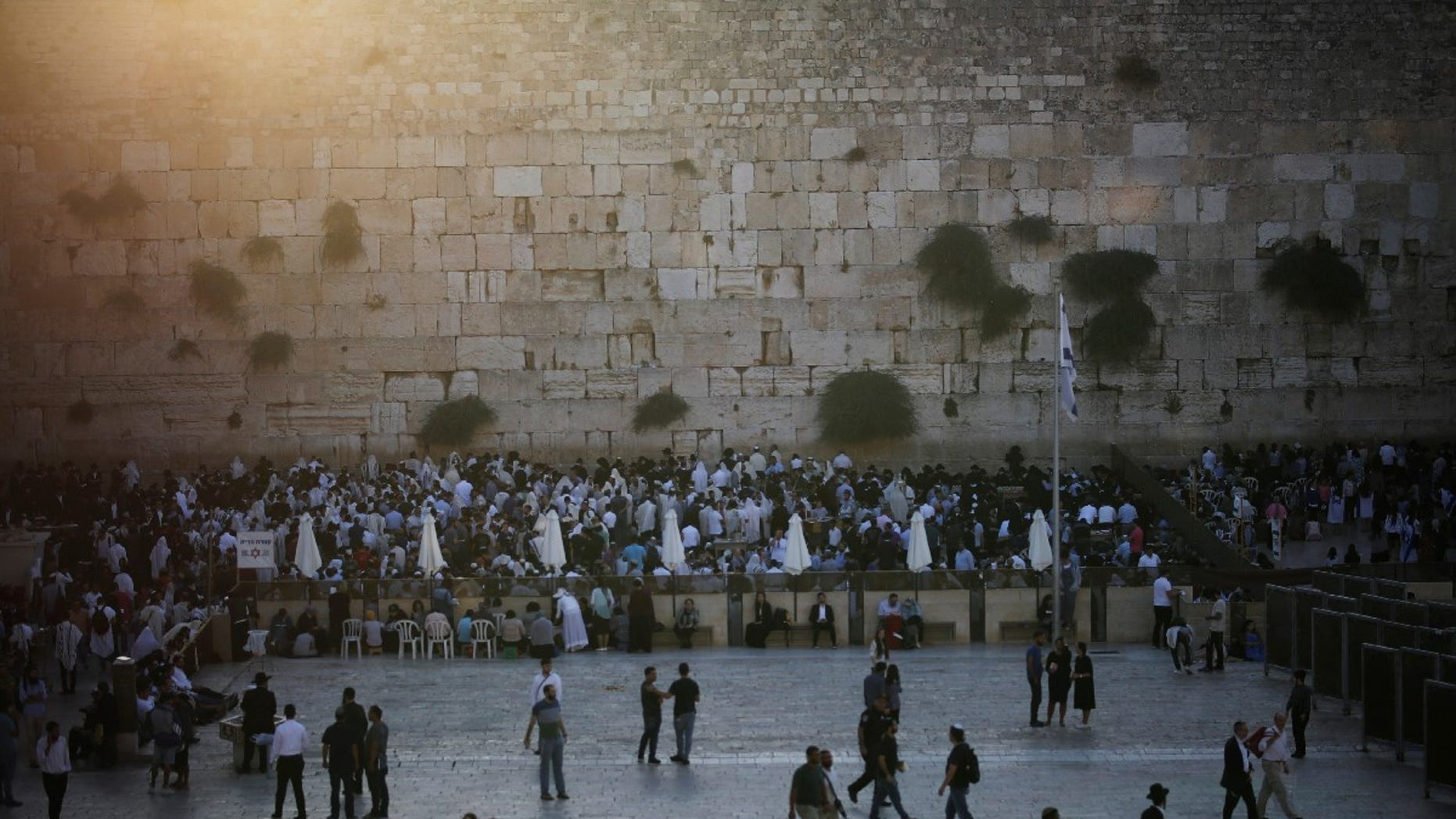Jewish worshipers pray in front of the Western Wall on Tisha B'Av, a day of fasting and lament, in Jerusalem's Old City August 1, 2017.