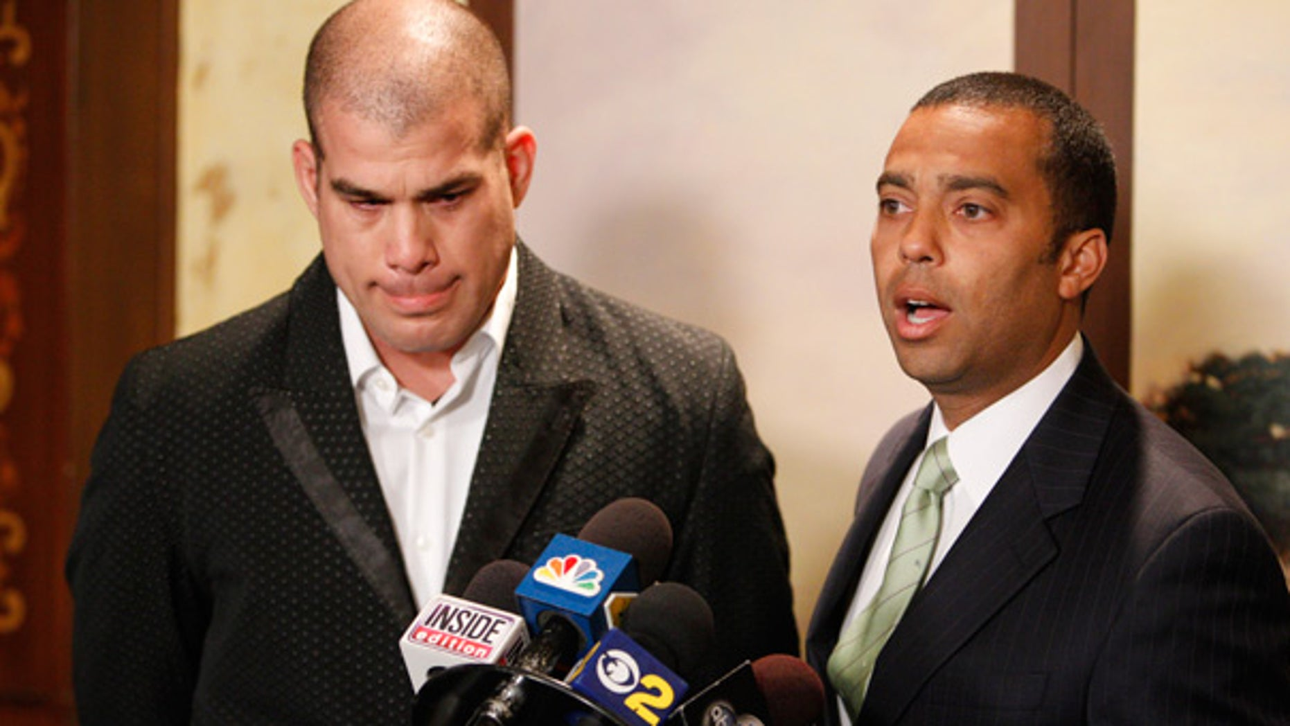 April 26: Former UFC champion Tito Ortiz listens as his attorney Chip Matthews speaks at the Firenze Osteria restaurant in North Hollywood.