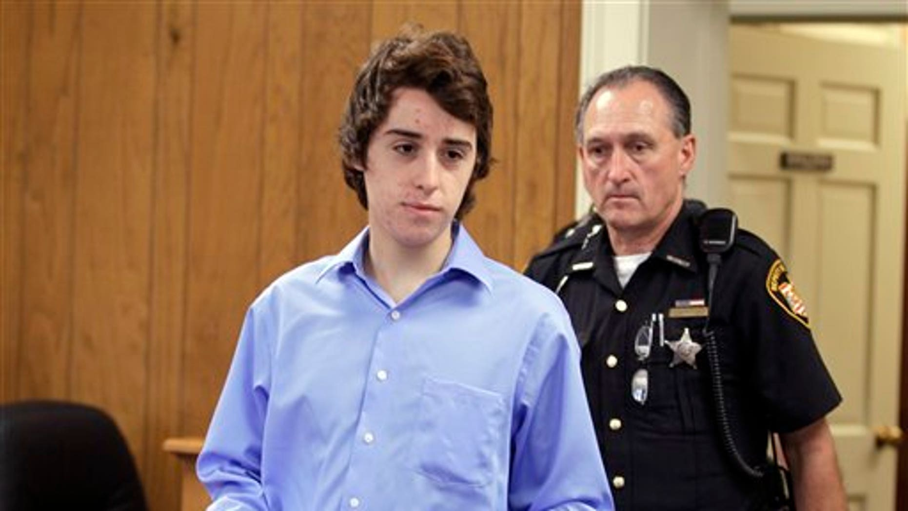 June 8, 2012: T.J. Lane is brought in to court for his arraignment by sheriff's deputies in Chardon, Ohio.