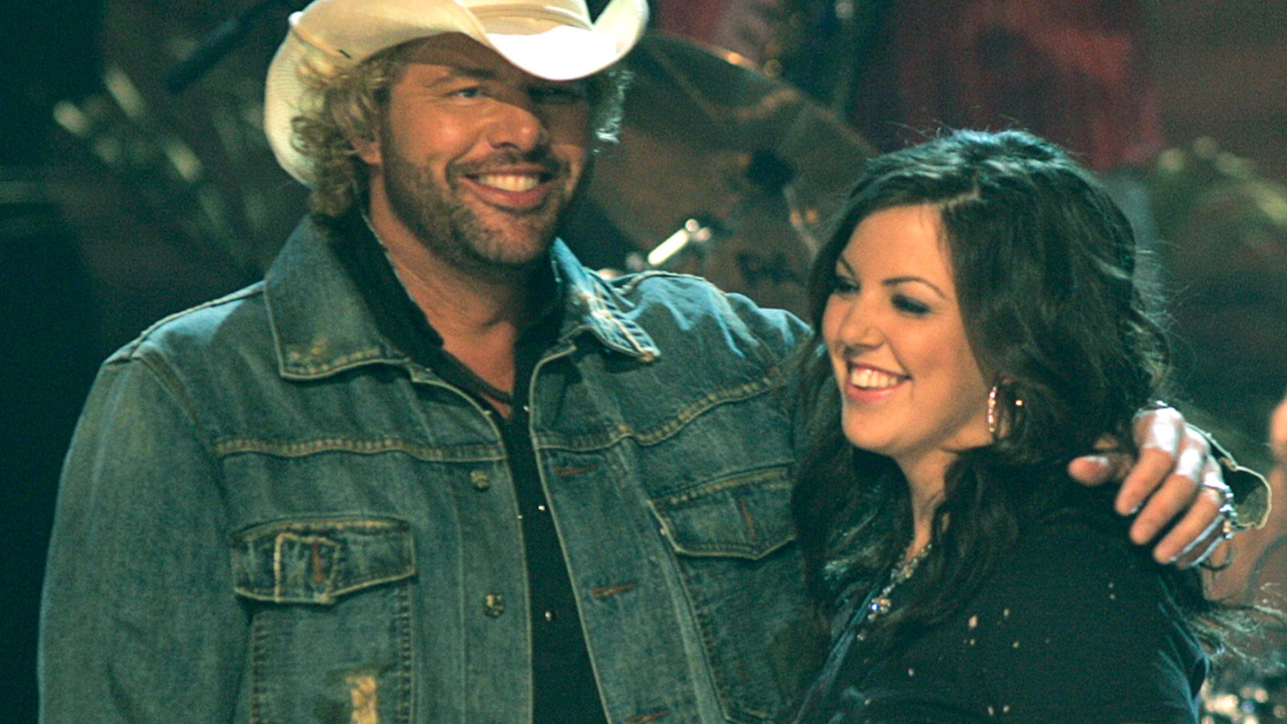 """Country Music artist Toby Keith and his daughter Krystal Sage onstage after performing """"Mockingbird"""" during the 38th annual Country Music Association Awards show at the Grand Ole Opry in Nashville, Tennessee, November 9, 2004."""