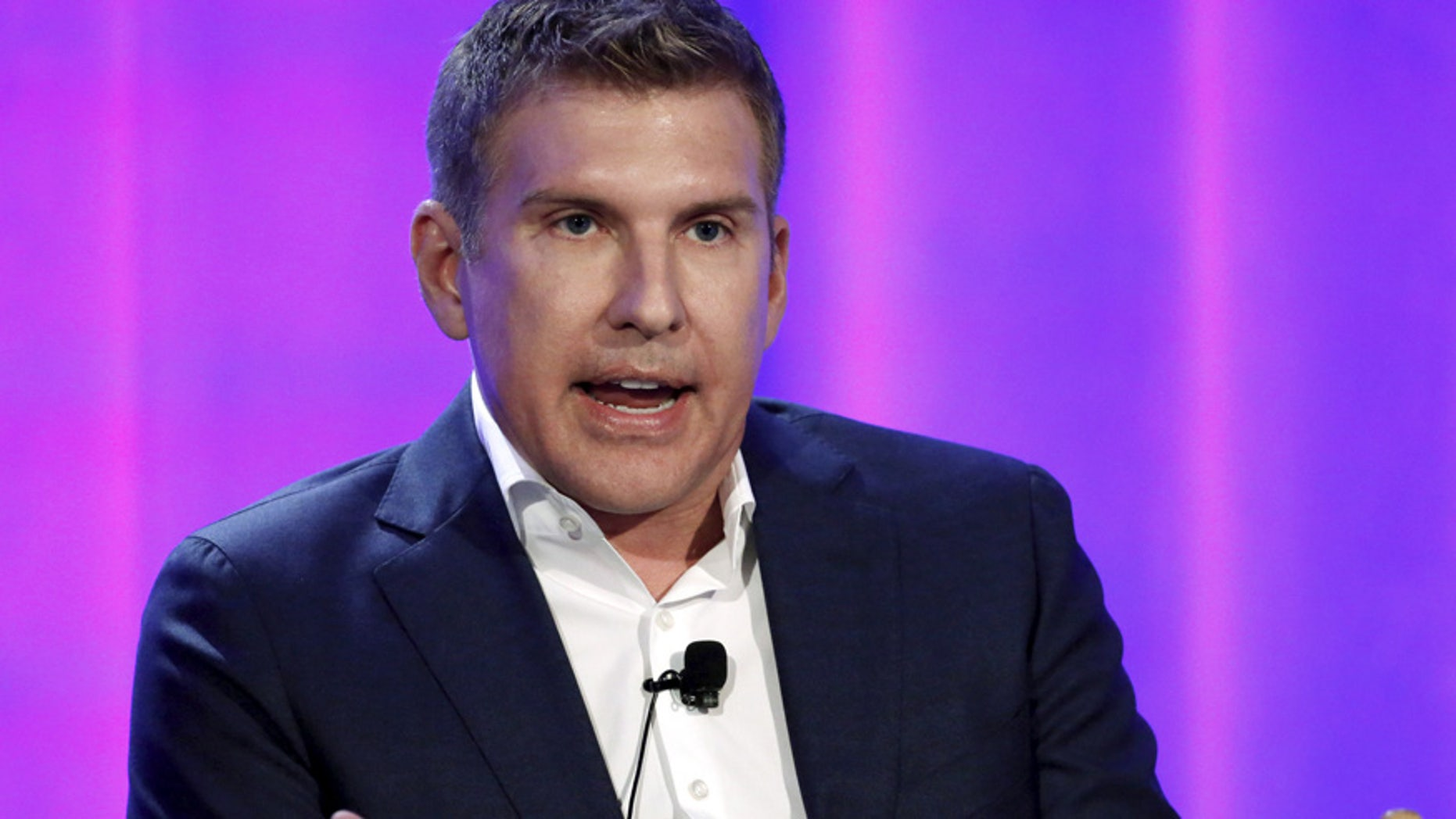 """Cast member Todd Chrisley speaks at a panel for the television series """"Chrisley Knows Best"""" during the NBCUniversal summer press day in Westlake Village, California, April 1, 2016. REUTERS/Mario Anzuoni - RTSD787"""