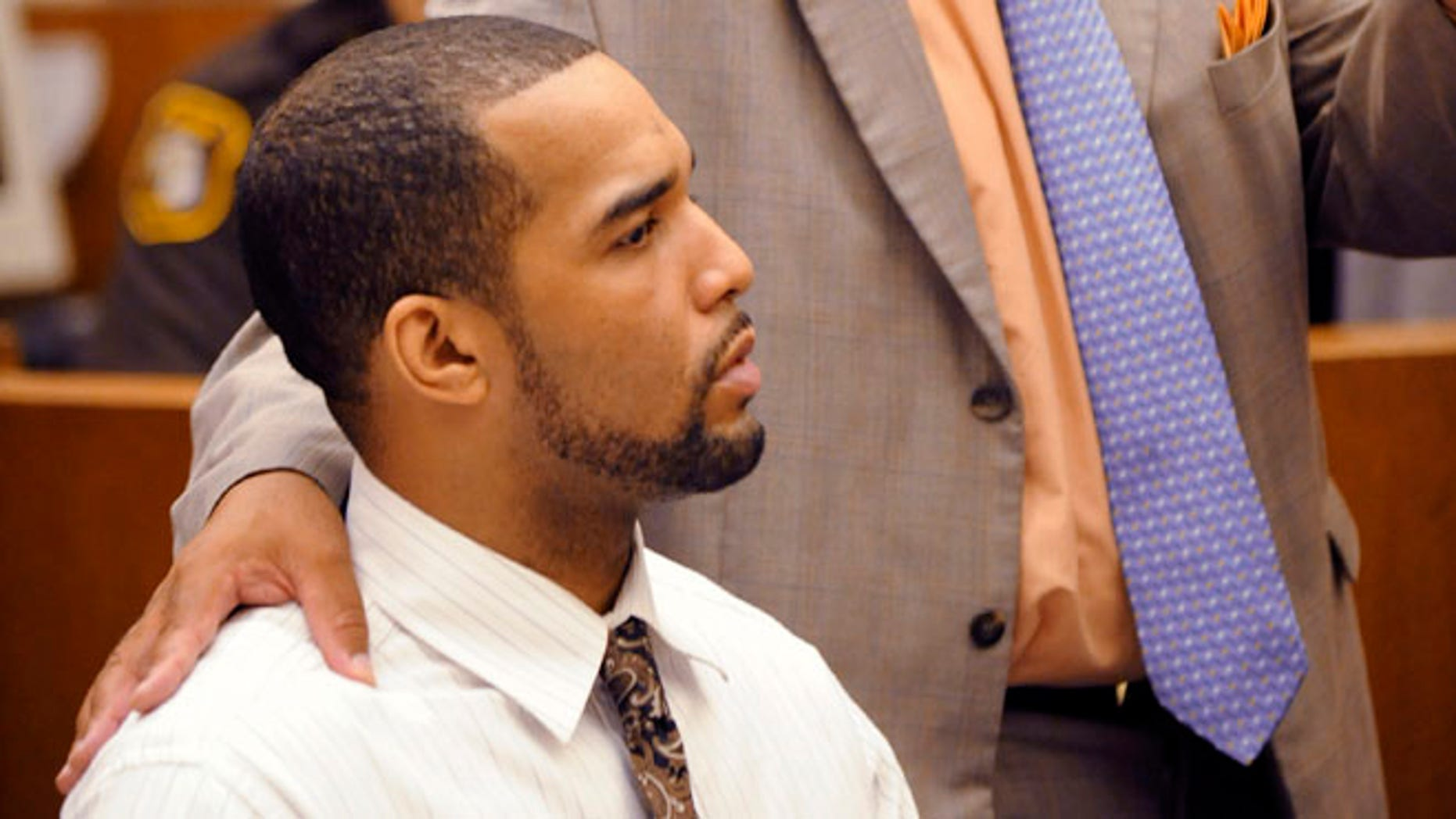 Sept. 19, 2012: D'Andre Lane, left, listens to his defense attorney Terry L. Johnson speak during Lane's trial before Judge Vonda R. Evans at Frank Murphy Hall of Justice in Detroit.