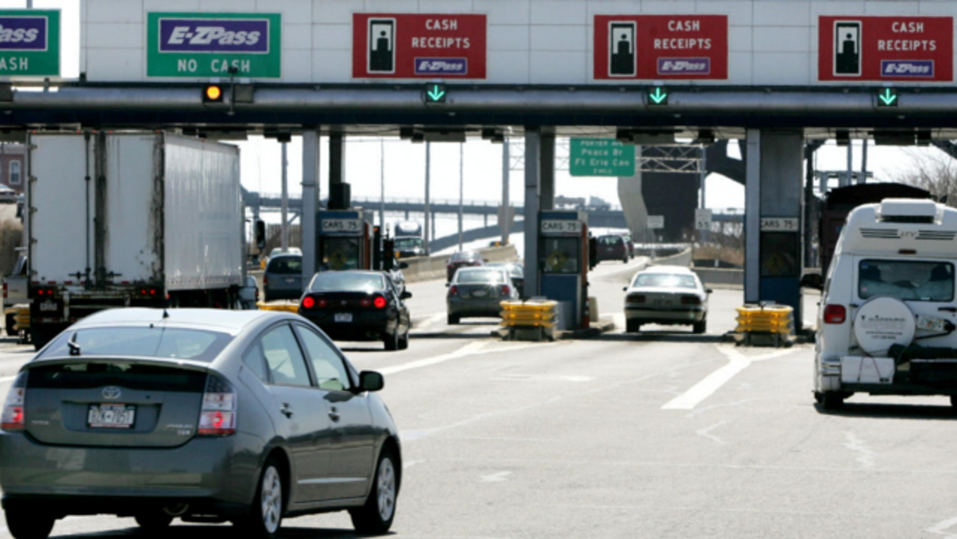 April 10, 2006: Motorists pass through a New York Thuway Authority toll booth, Buffalo, New York.