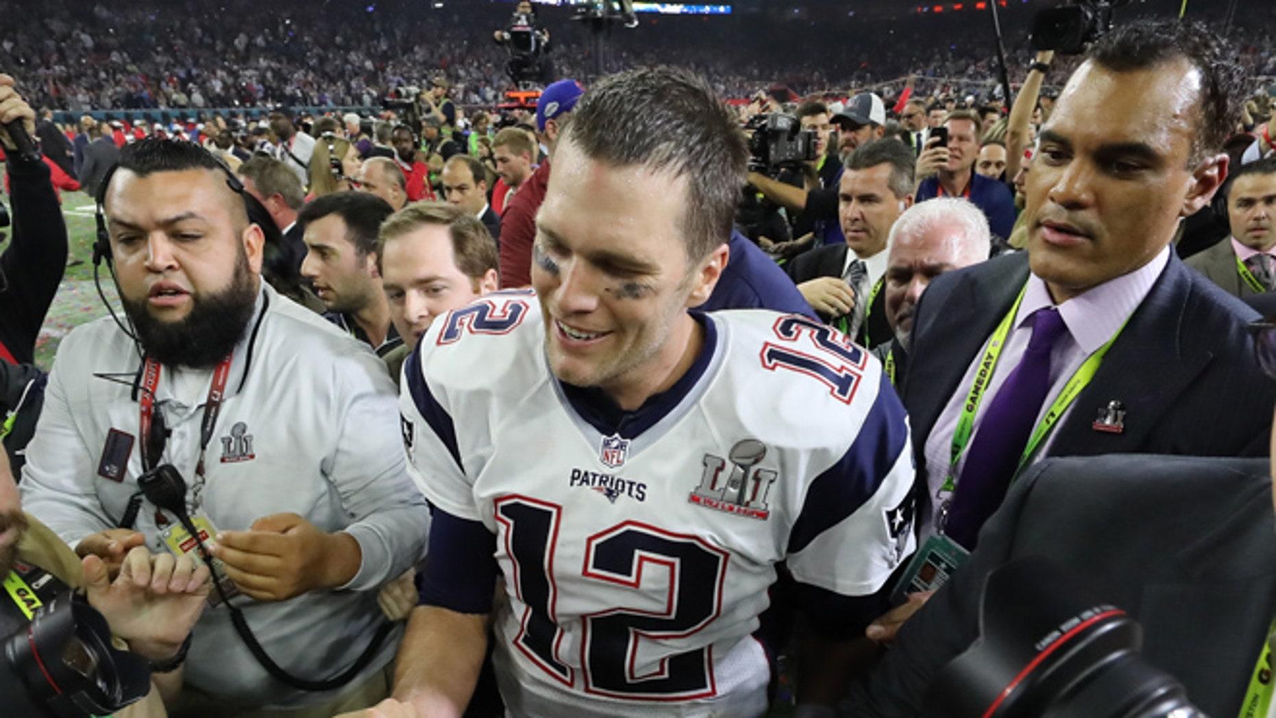 New England Patriots' quarterback Tom Brady smiles after his team defeated the Atlanta Falcons at Super Bowl LI in Houston, Texas, U.S., February 5, 2017. REUTERS/Adrees Latif - RTX2ZRK0