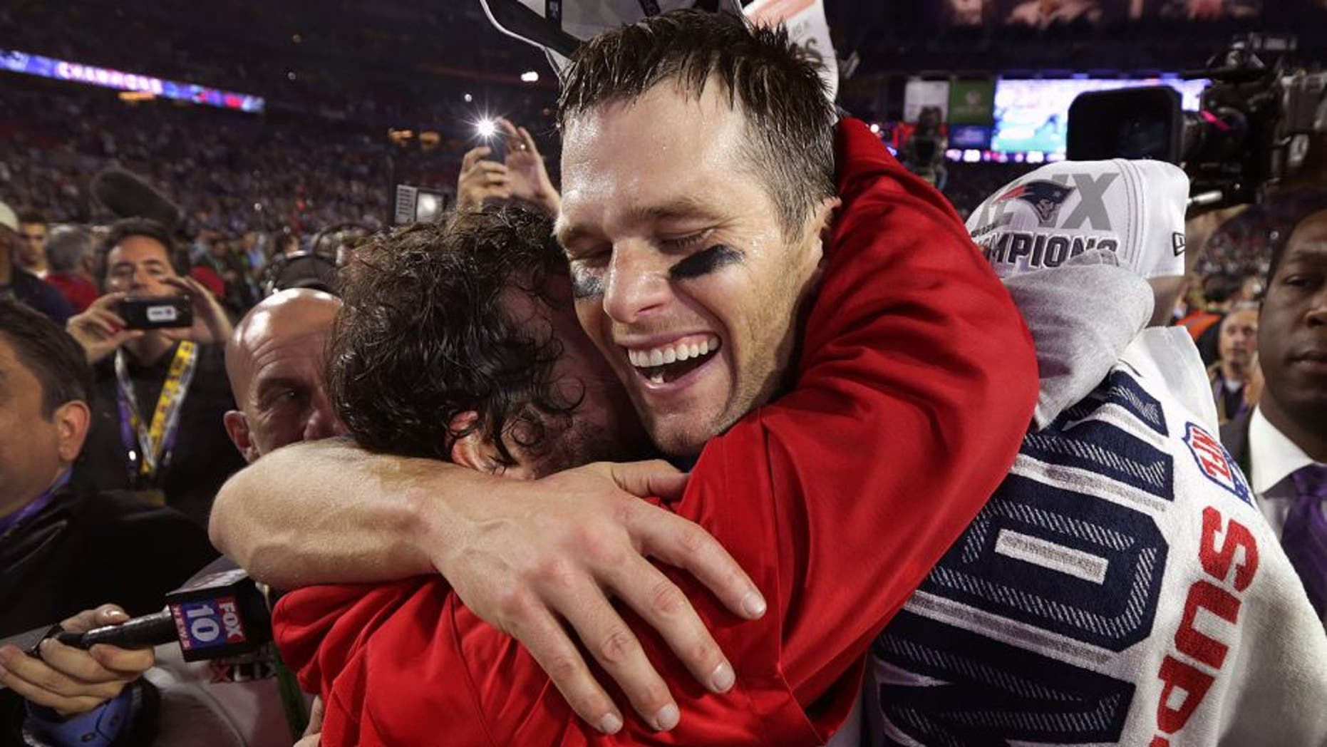 GLENDALE, AZ - FEBRUARY 1: New England Patriots quarterback Tom Brady shares a hug with Patriots defensive coordinator Matt Patricia after winning Super Bowl XLIX. (Photo by Barry Chin/The Boston Globe via Getty Images)