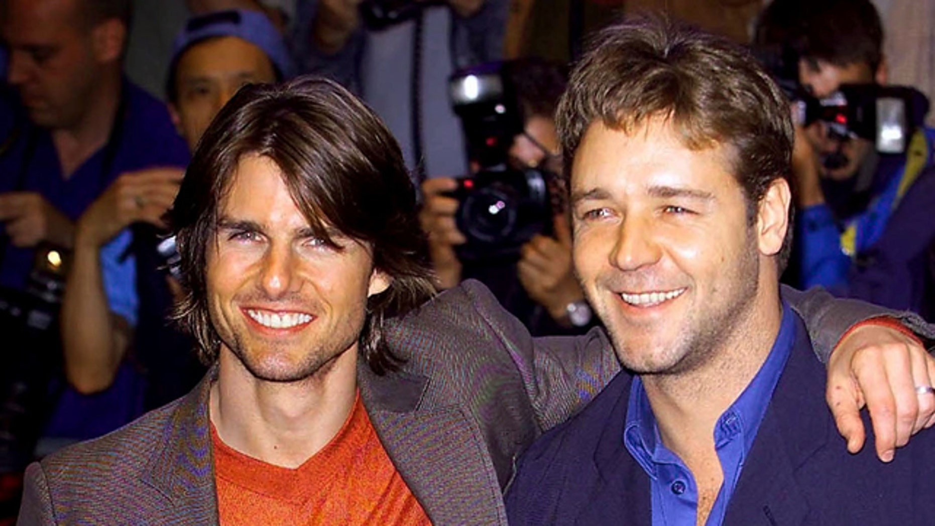 """4 July 2000. Film stars Tom Cruise (L) and Russell Crowe pose together as they arrive at the premiere of """"Mission Impossible Two"""" in central London."""