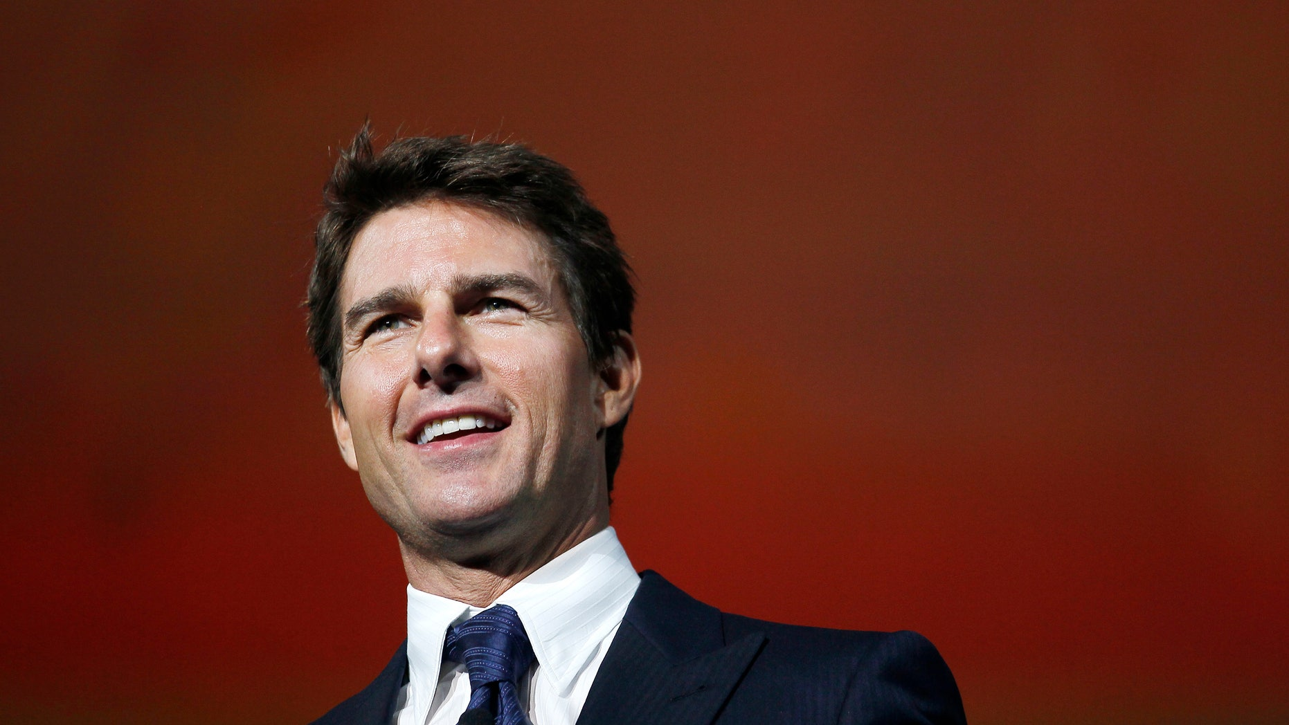 Actor Tom Cruise arrives on stage at the annual shareholders meeting for Walmart in Fayetteville, Arkansas June 7, 2013.