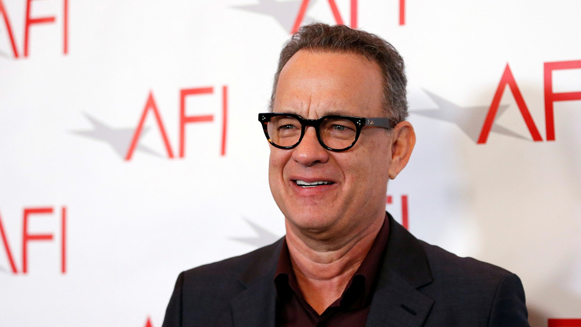 Actor Tom Hanks poses at the AFI AWARDS 2017 luncheon in Los Angeles, California, U.S., January 5, 2018. REUTERS/Mario Anzuoni - RC1480564750