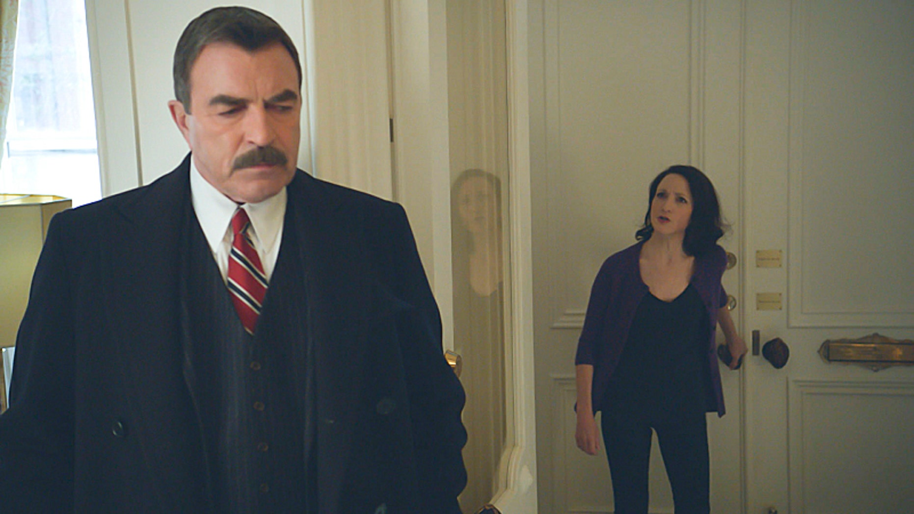 "Bebe Neuwirth as Kelly Peterson and Tom Selleck, left, as Frank Reagan in ""Blue Bloods."""