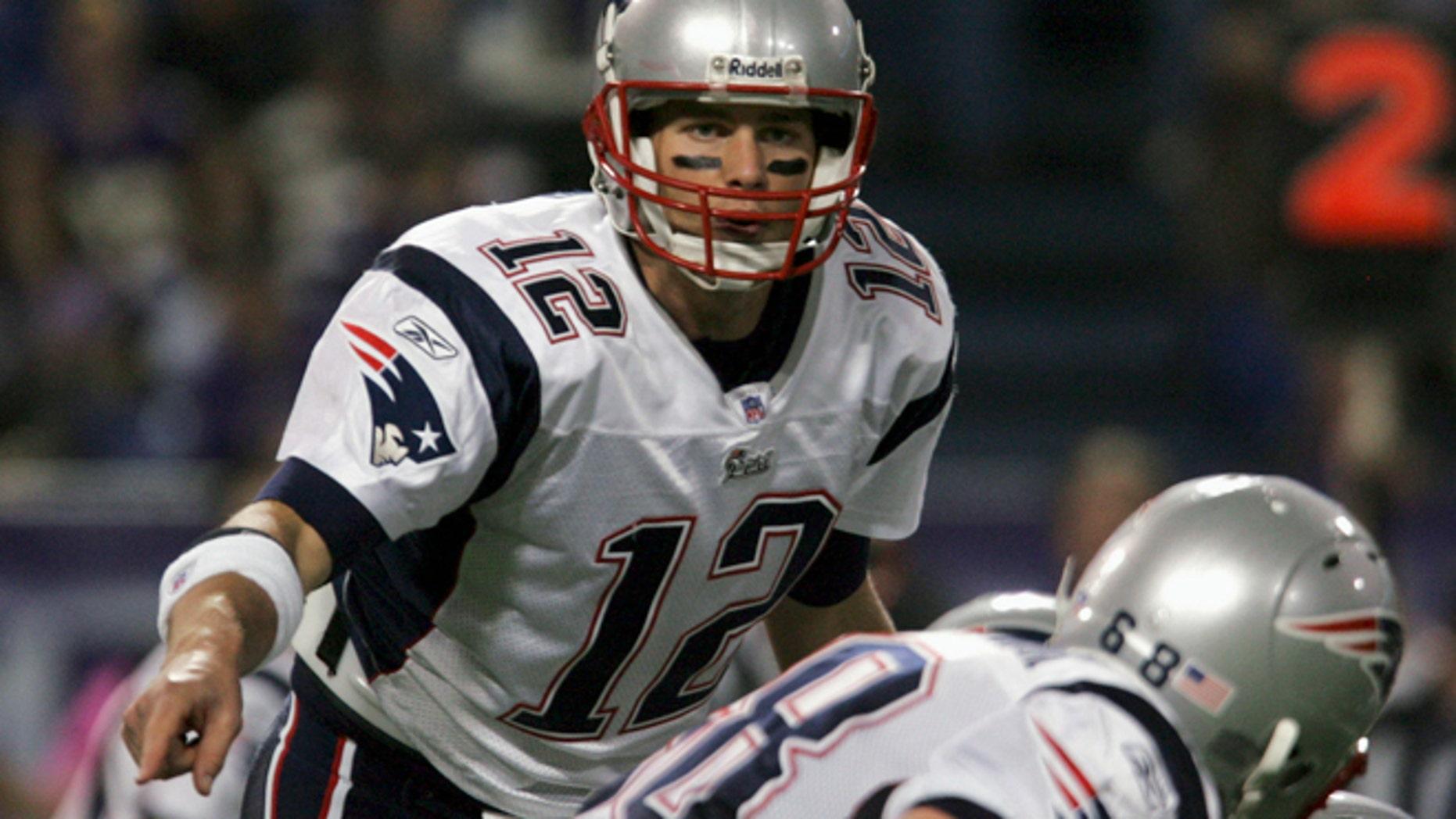 FILE 2006: New England Patriots quarterback Tom Brady calls an audible.