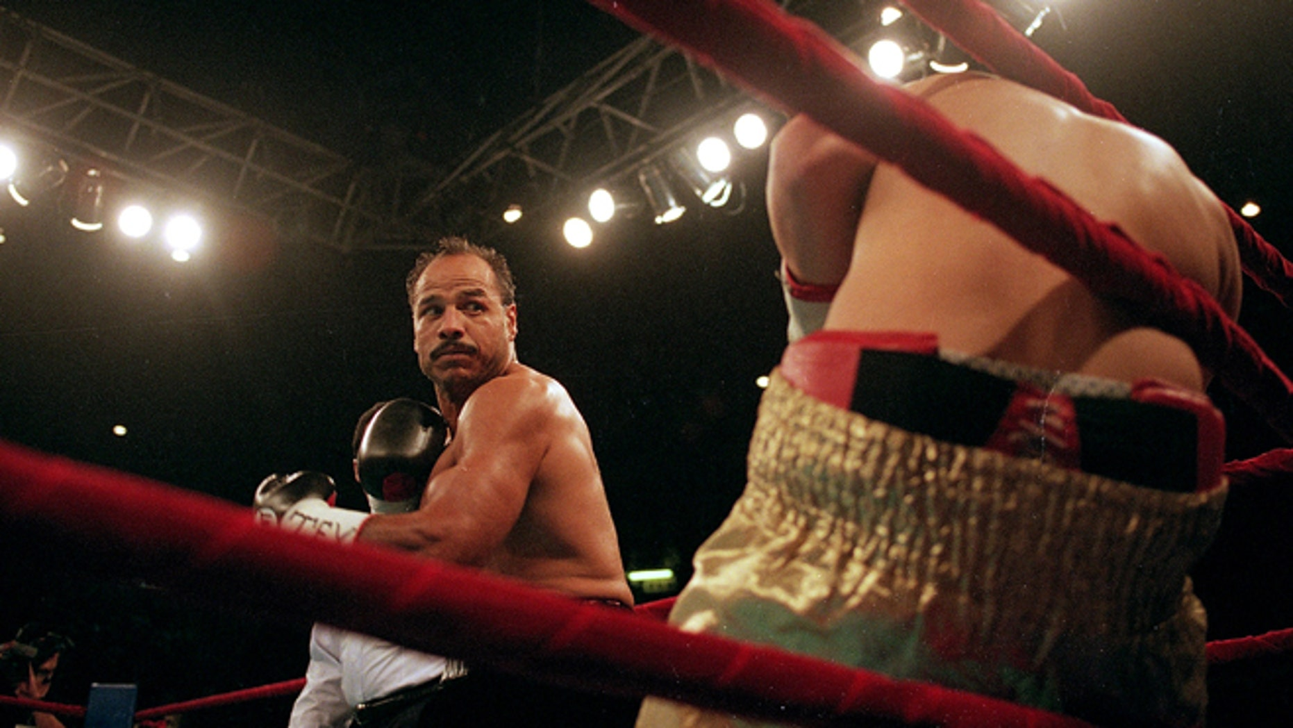 20 Aug 1999:  Tony Ayala Jr. connects with a left hook during the fight against Manuel Esparaza at the Freeman Coliseum in San Antonio, Texas. Tony Ayala Jr. wins by a Technical Knock Out in the third Round. Mandatory Credit: Ronald Martinez  /Allsport