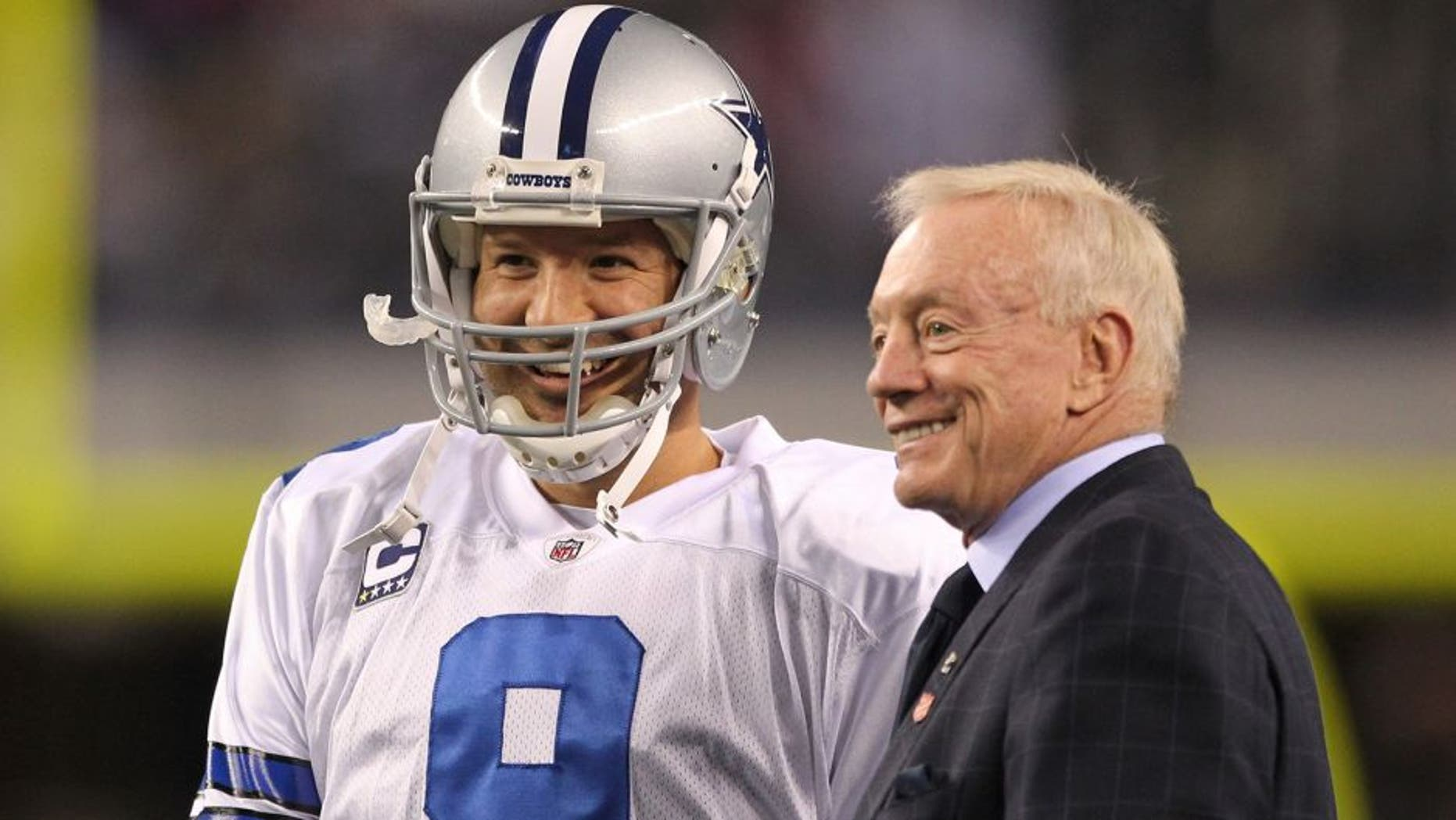 Dec 11, 2011; Dallas, TX, USA; Dallas Cowboys quarterback Tony Romo (9) meets with owner Jerry Jones prior to the game against the New York Giants at Cowboys Stadium. Mandatory Credit: Richard Rowe-USA TODAY Sports