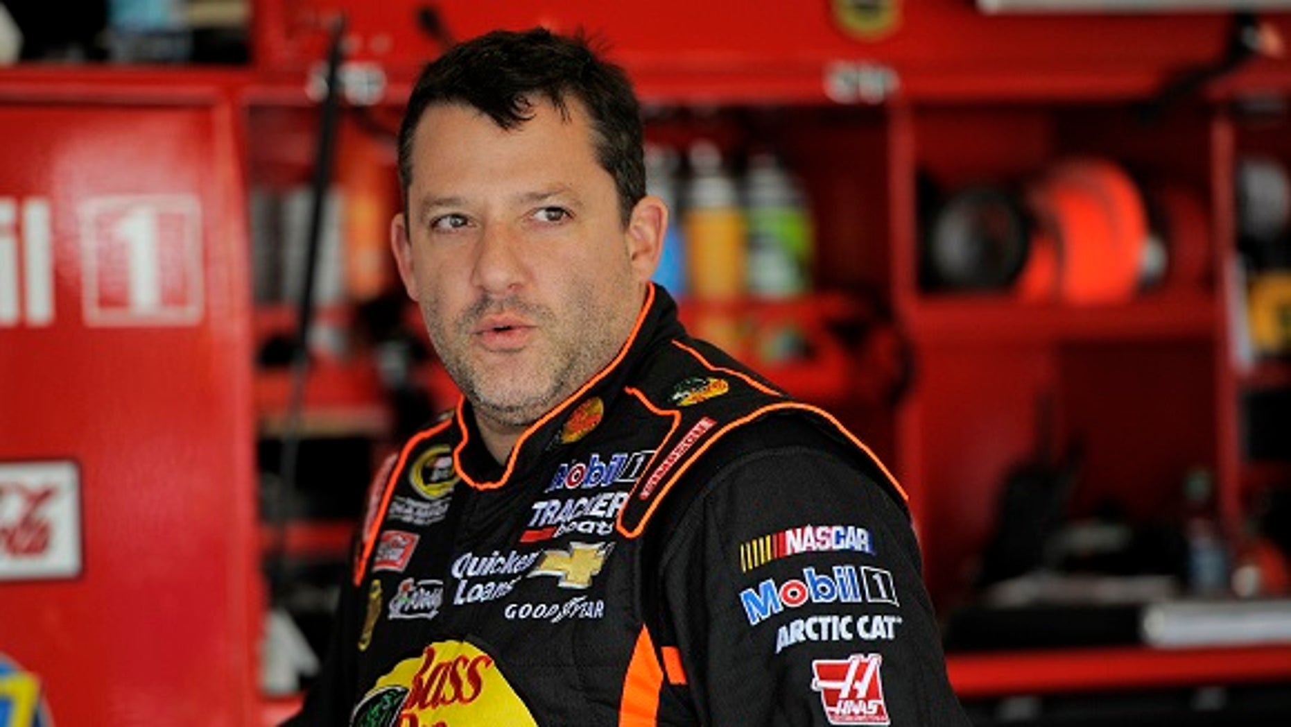 A Florida woman was taken into custody after being accusing of stalking NASCAR star Tony Stewart.