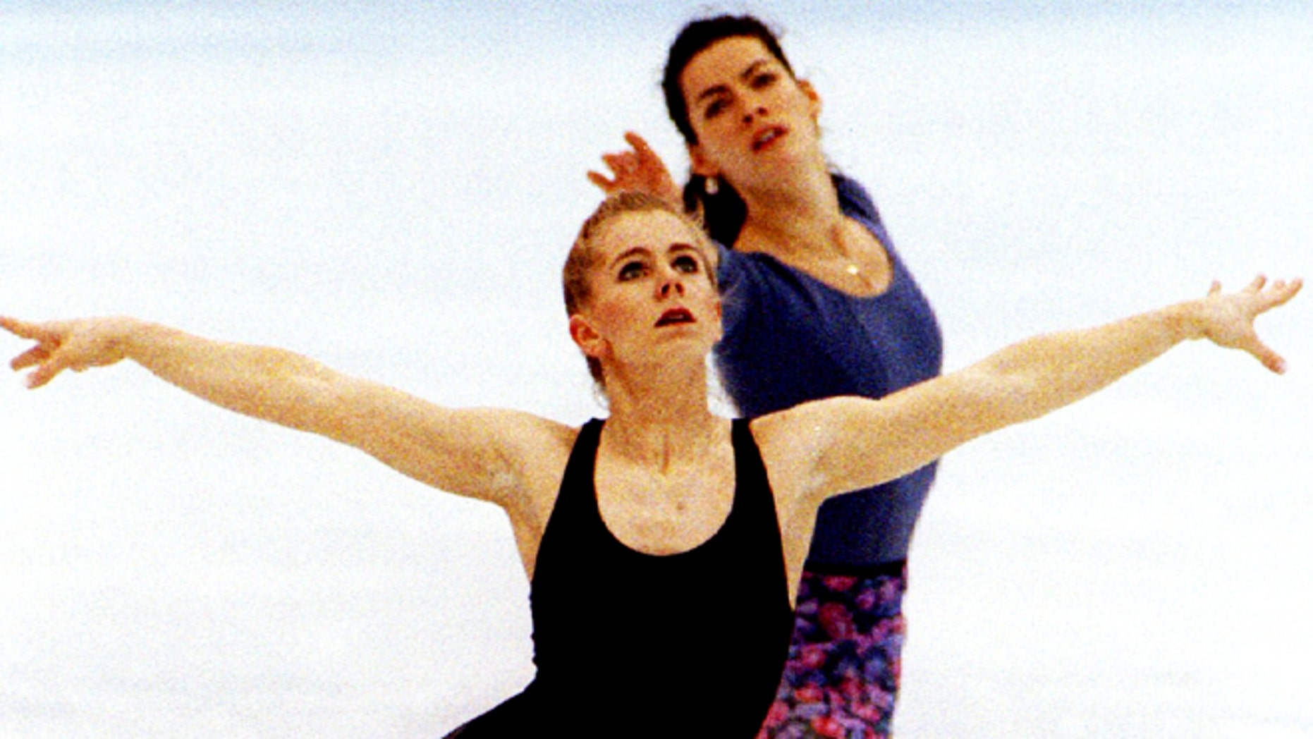 USA figure skaters Tonya Harding (L) and Nancy Kerrigan practice their technical programmes together during a practice session at Hamar's Olympic Amphitheatre on February 22 - RTXFH8S