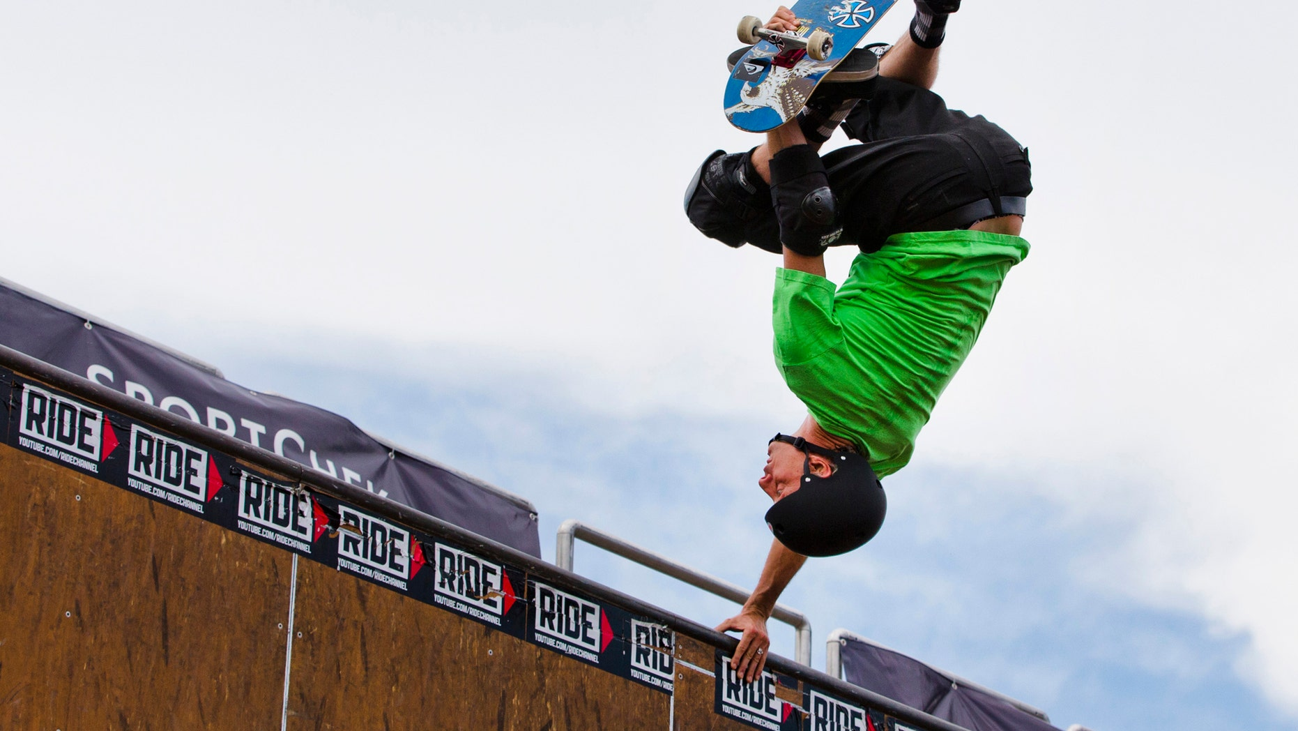 """File photo - Legendary skateboarder Tony Hawk performs during the """"Tony Hawk Tour"""" in Toronto, July 18, 2013. (REUTERS/Mark Blinch)"""