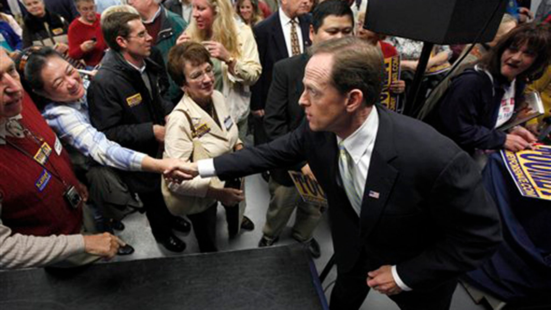 In this Oct. 22 photo, Pennsylvania Republican Senate candidate Pat Toomey meets with supporters at a rally in Blue Bell, Pa. (AP Photo)