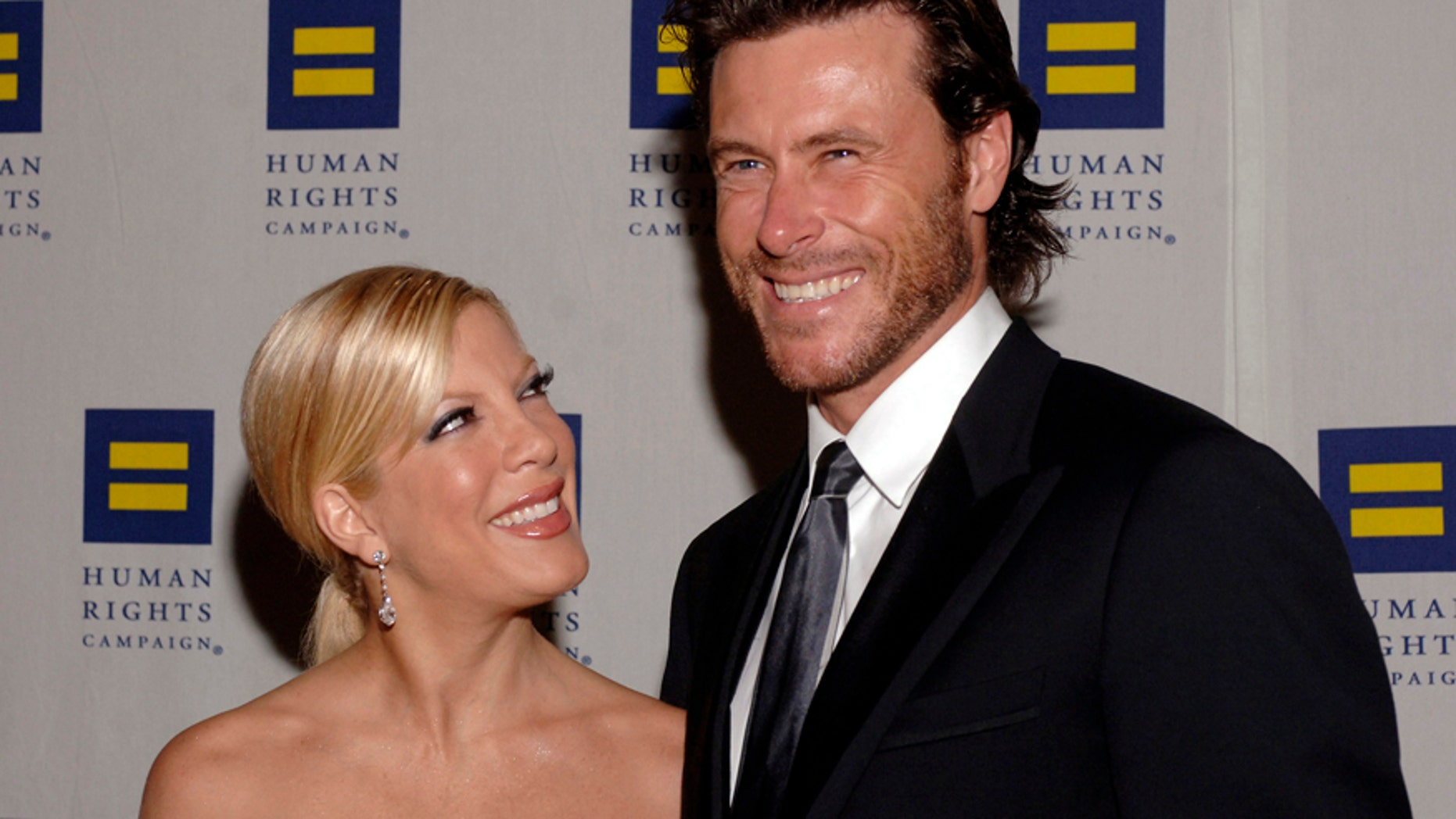 Actress Tori Spelling, left, and husband Dean McDermott, right, have reportedly begun counseling to turn their marriage around.