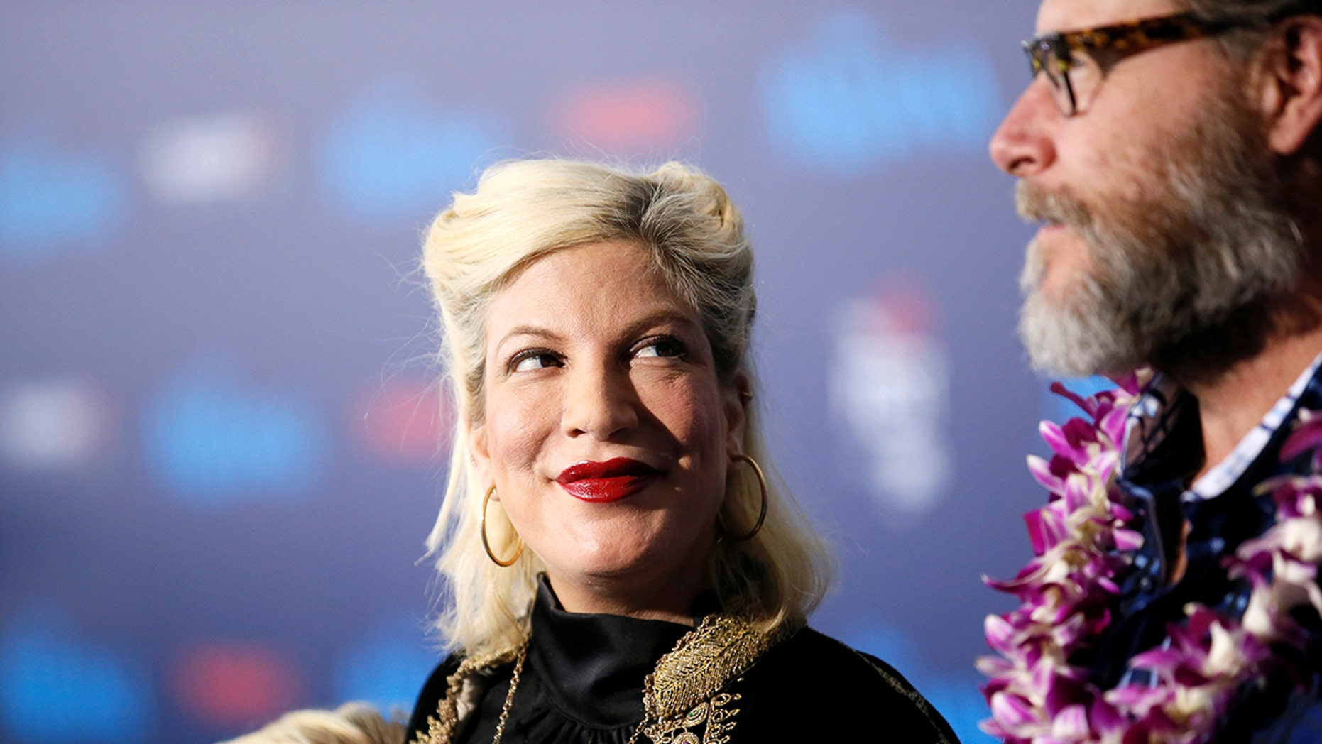"""Actor Tori Spelling and husband Dean McDermott pose at the world premiere of Walt Disney Animation Studios' """"Moana"""" as a part of AFI Fest in Hollywood, California, Nov. 14, 2016."""