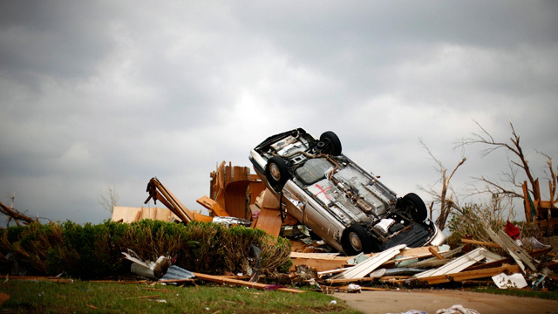 A car lies on its back, overturned by a tornado that struck Joplin, Missouri.