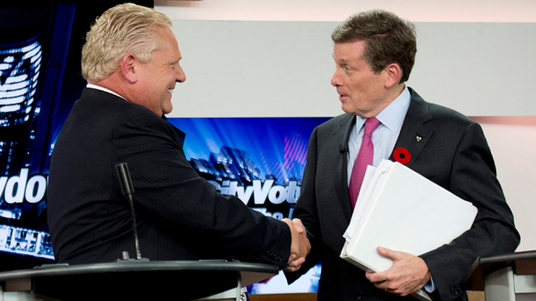 Oct. 23, 2014: Toronto mayoral candidates Doug Ford, left, and John Tory shake hands during the final mayoral debate for the Toronto mayoral race in Toronto.