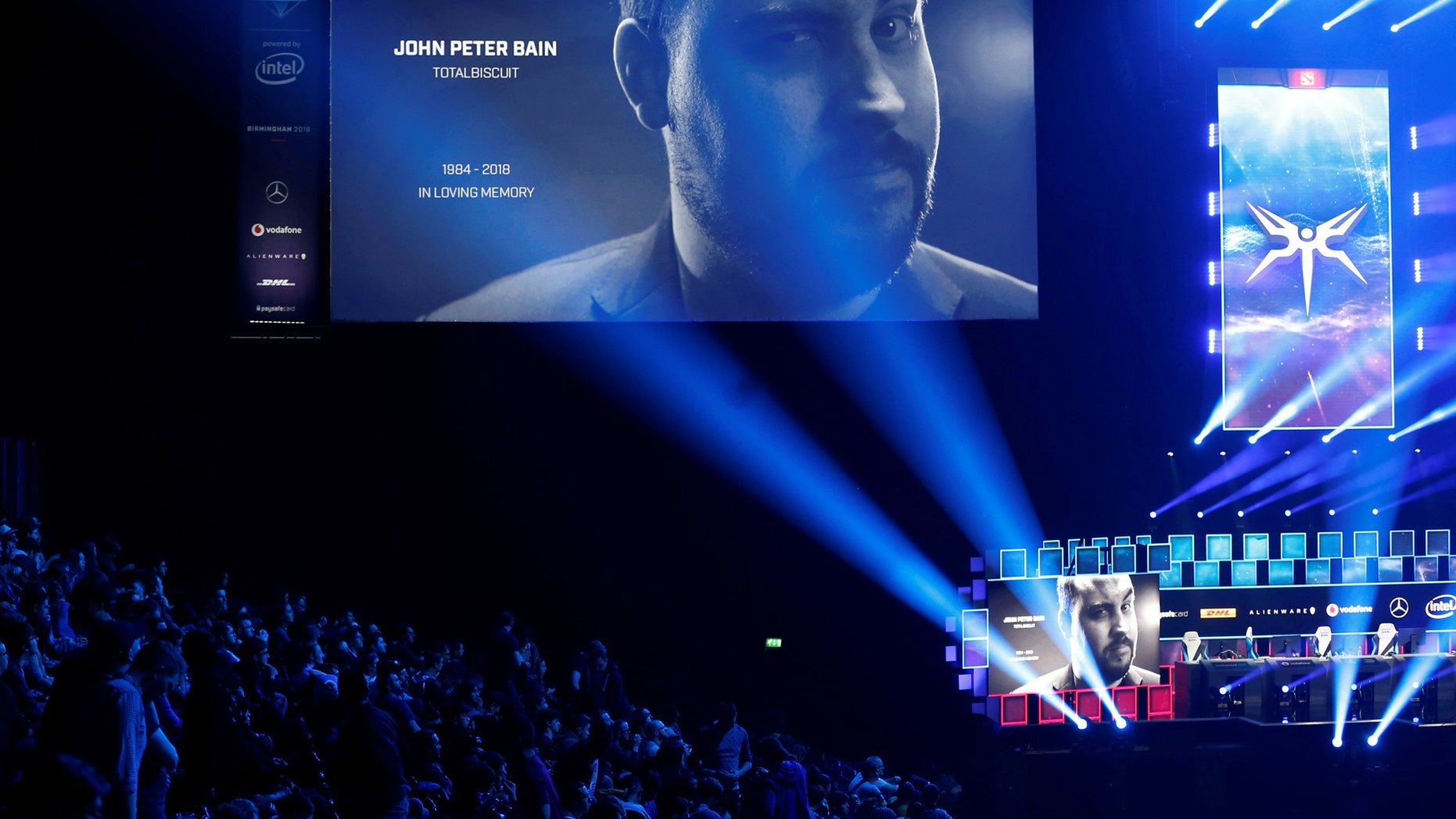 Esports - ESL One - Dota 2 Major - Arena Birmingham, Birmingham, Britain - May 26, 2018  Fans observe a minute's silence in memory of YouTube star John Peter Bain, also known as TotalBiscuit  Action Images via Reuters/Ed Sykes - RC1B610D2F90