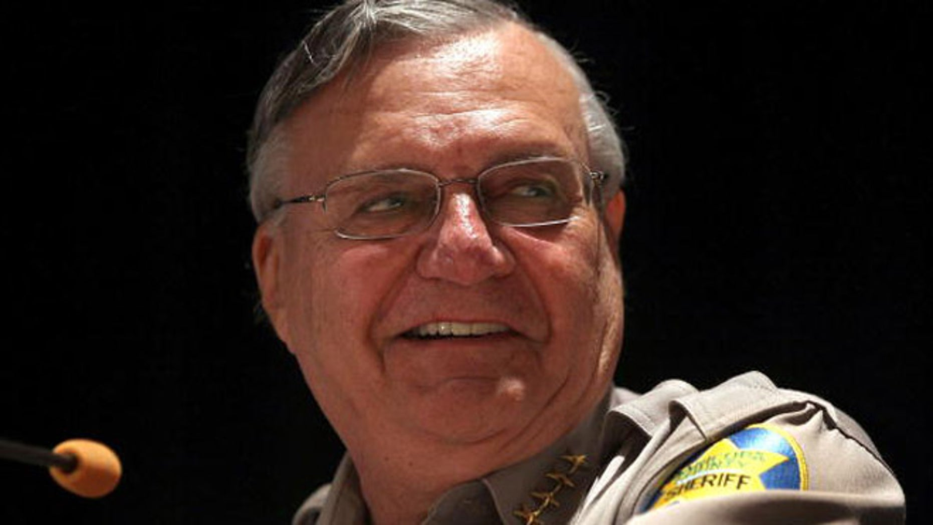 "PHOENIX - APRIL 29:  Maricopa County sheriff Joe Arpaio speaks to participants of the Border Security Expo on April 29, 2010 in Phoenix, Arizona. Arpaio, promoted by his supporters as ""America's Toughest Sheriff"", voiced his support for Arizona's new immigration enforcement law. His deputies conduct frequent sweeps to arrest undocumented immigrants in his county, which includes the state capitol Phoenix.  (Photo by John Moore/Getty Images)"