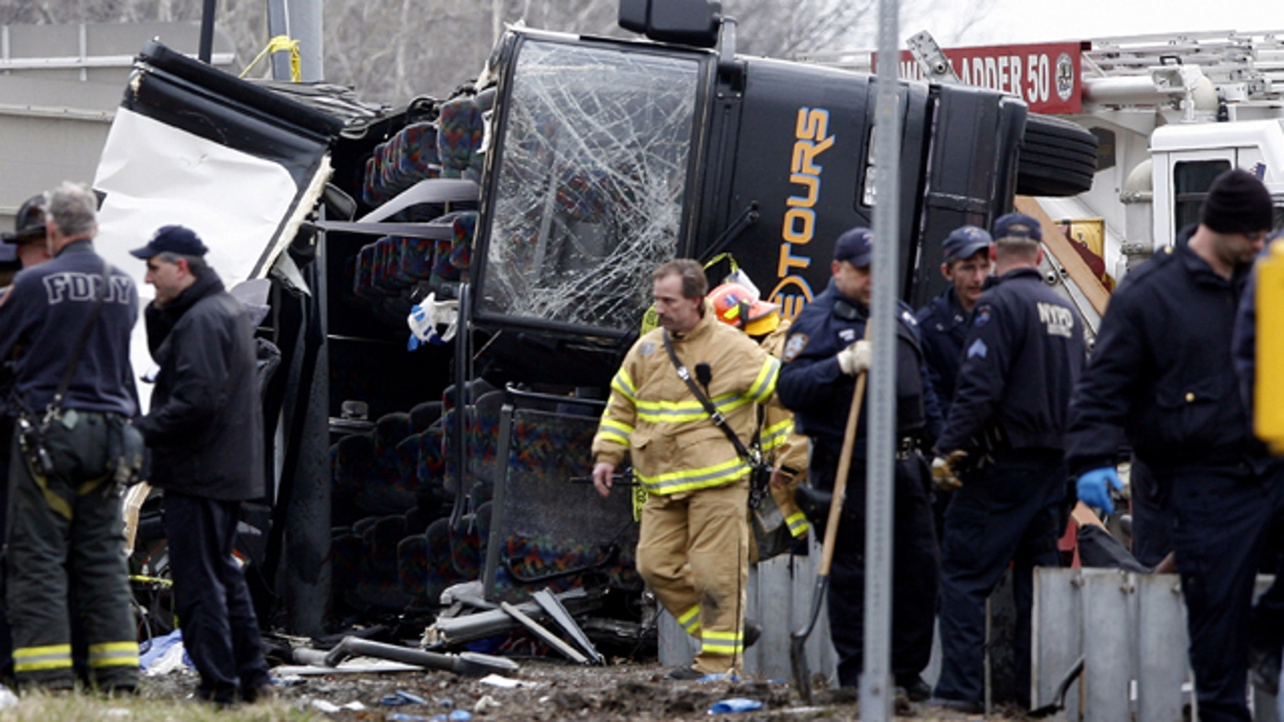 March 12, 2011: Emergency personnel investigate the scene of a bus crash on Interstate-95 in the Bronx borough of New York. Fifteen people died when the bus, returning to New York from a casino in Connecticut, flipped onto its side and was sliced in half by the support pole for a large sign.