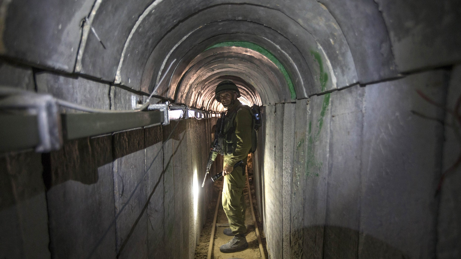 July 25, 2014: In this file photo, an Israeli army officer gives journalists a tour of a tunnel allegedly used by Palestinian militants for cross-border attacks, at the Israel-Gaza Border.