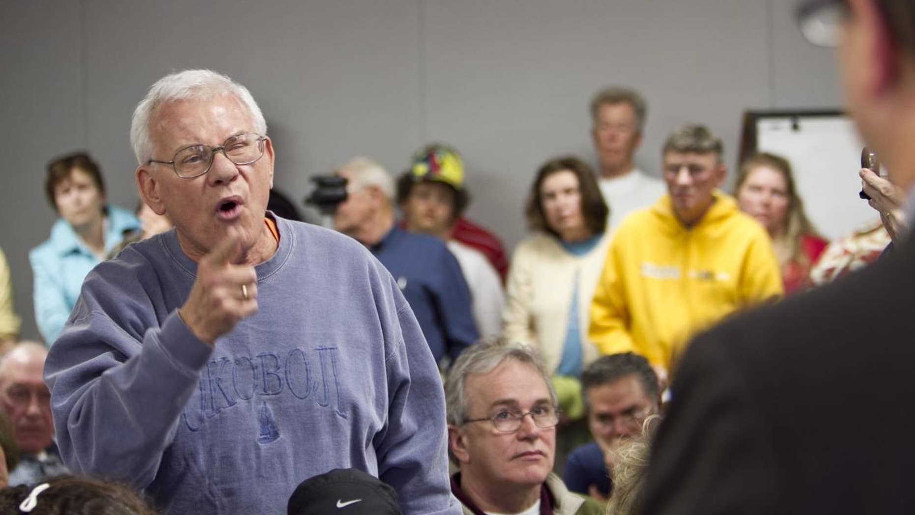 William Kouth of Omaha addresses Rep. Lee Terry R-Neb., during a town hall meeting held to discuss the Republican party's plan to privatize Medicare, in Omaha, Neb., Thursday, April 28, 2011. (AP Photo/Nati Harnik)