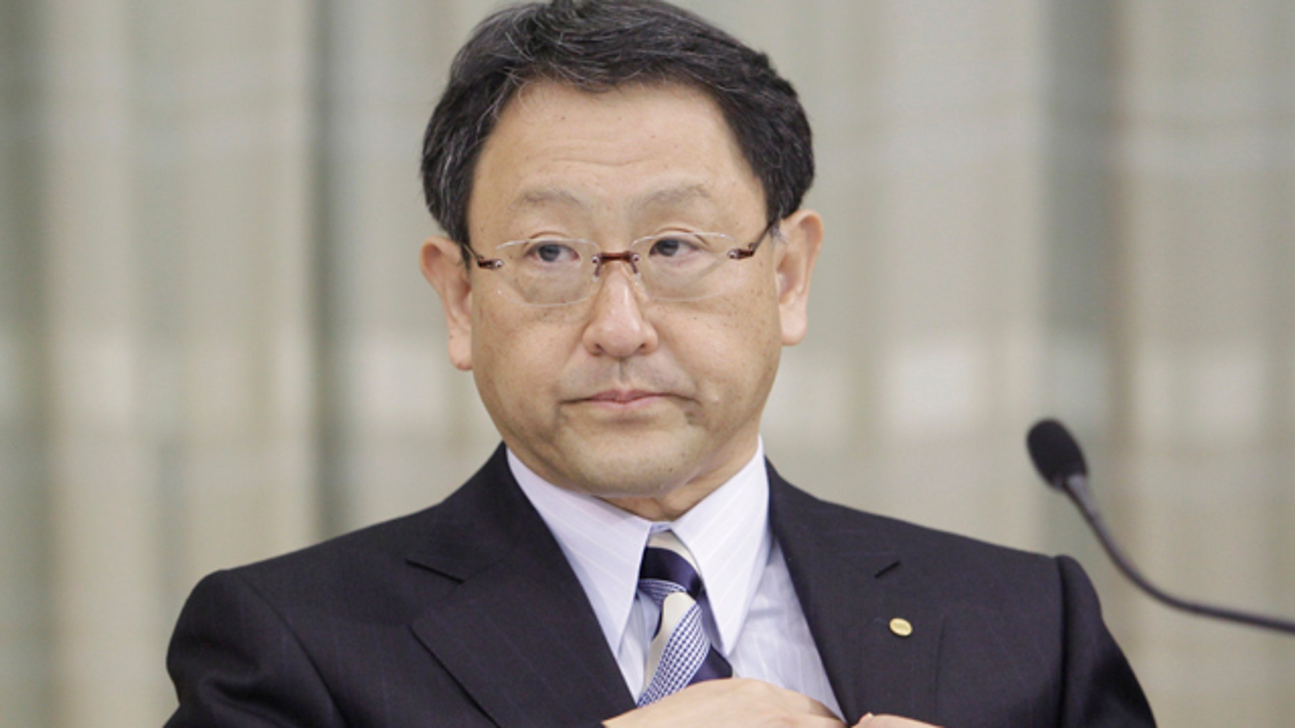 April 22: Toyota Motor Corp. President Akio Toyoda attends a press conference in Tokyo. Toyota said its global car production, disrupted by parts shortages from Japan's earthquake and tsunami, won't return to normal until November or December -- threatening its spot as the world's top-selling automaker. (AP)