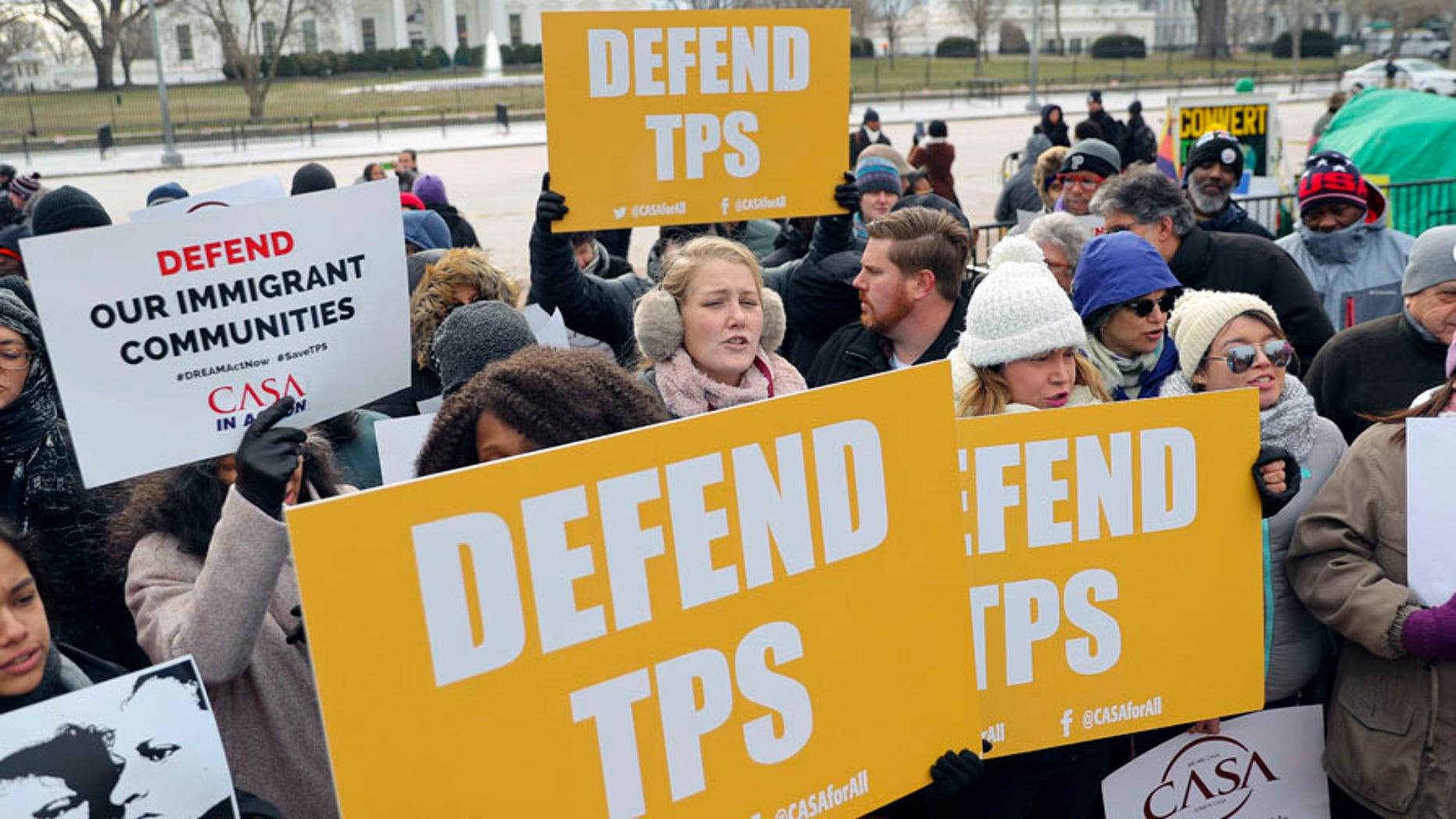 Demonstrators protest the Trump administration's decision to strip TPS for Salvadorans in the U.S.