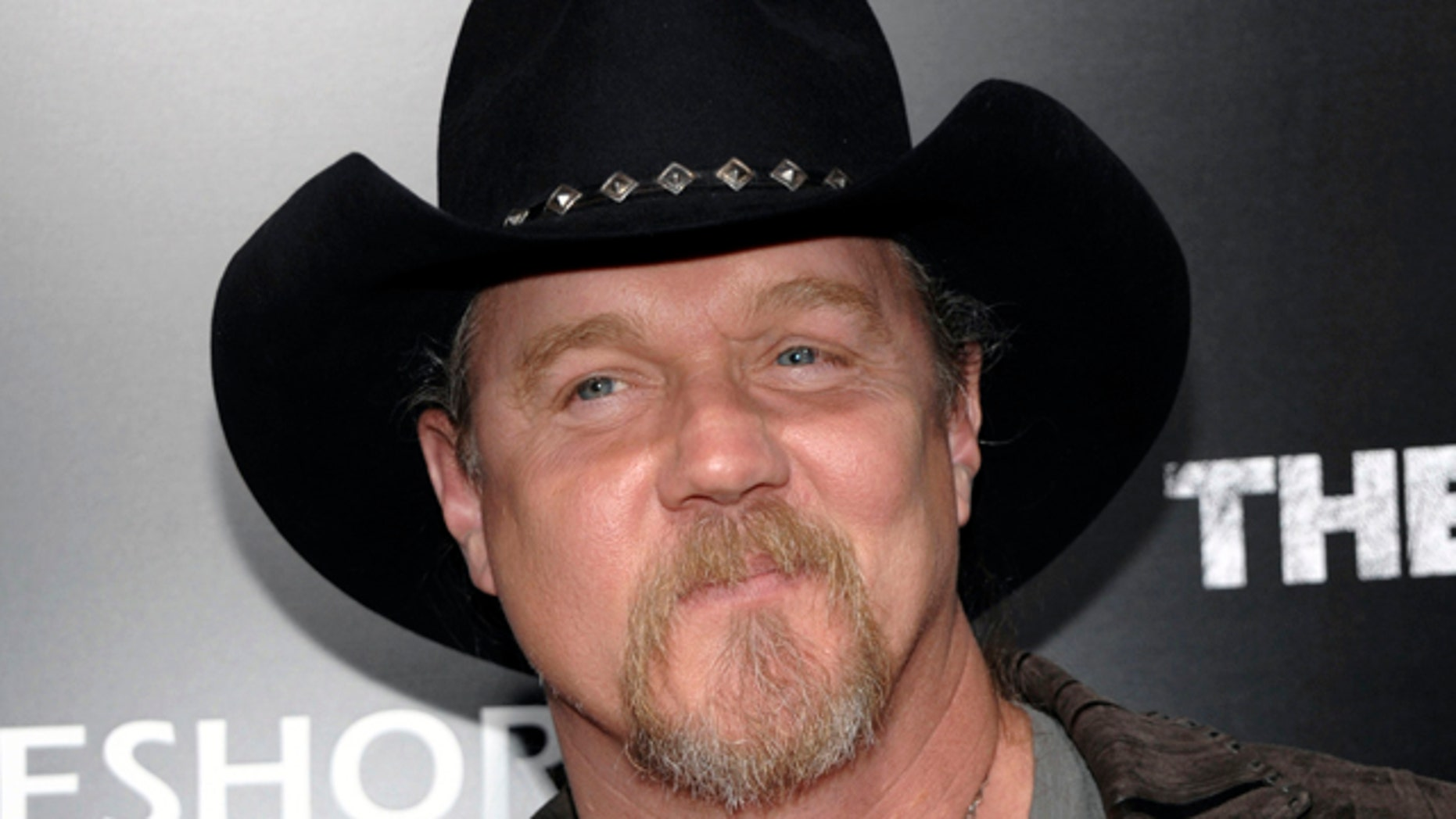 """FILE - In this March 10, 2011 file photo, musician Trace Adkins arrives at the premiere of the feature film """"The Lincoln Lawyer"""" in Los Angeles. Country music star Trace Adkins has lost his home to a fire."""