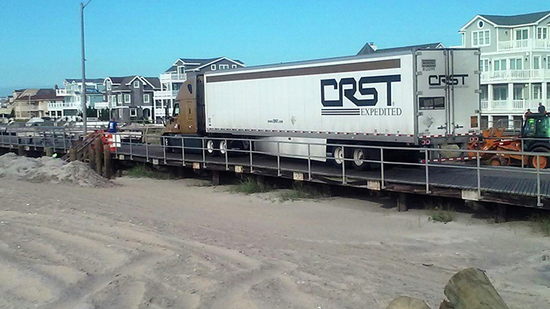 Tractor Trailer Makes Wrong Turn And Gets Stuck On New Jersey Beach