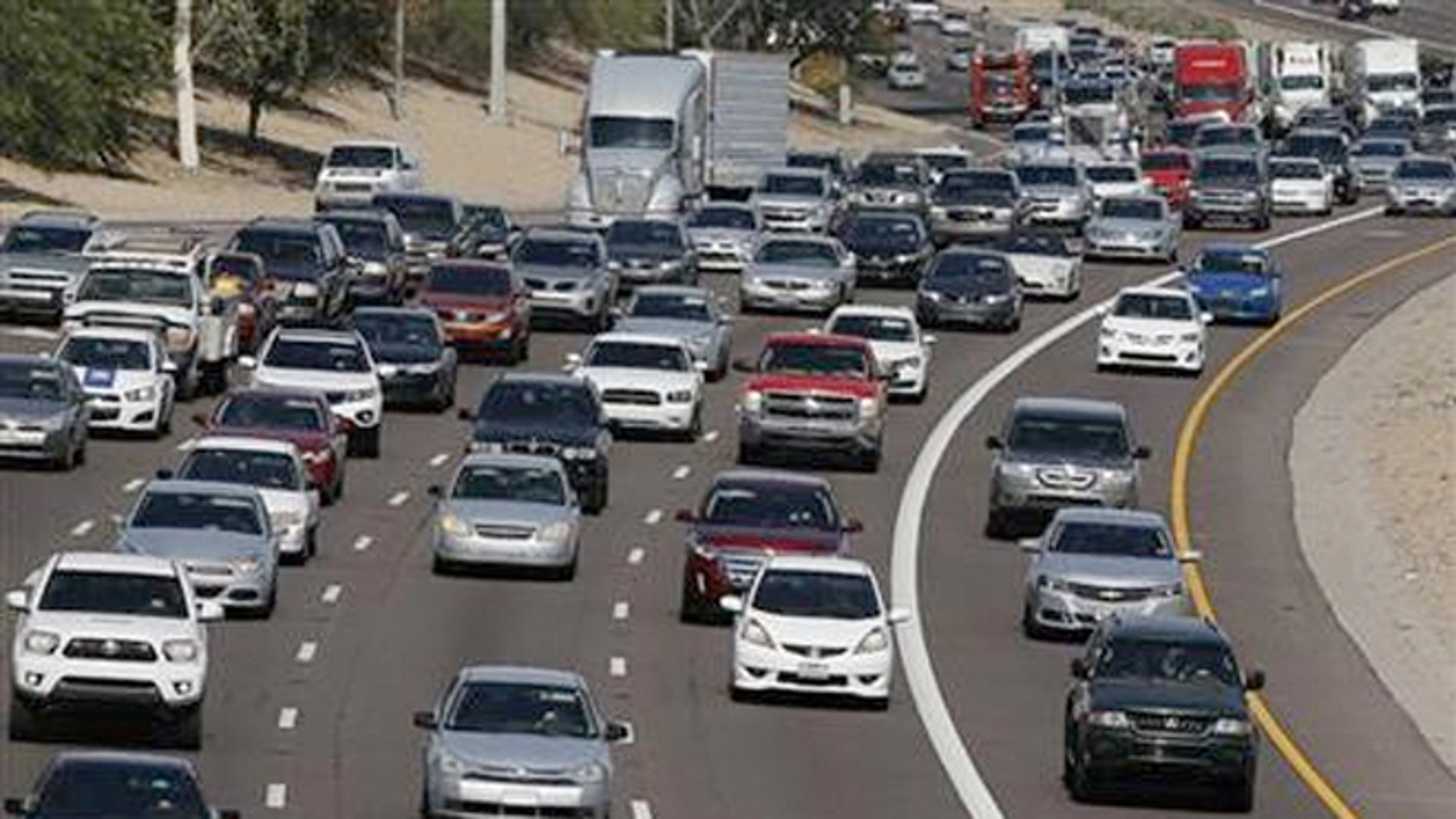 Low gas prices and an improving economy will prompt Americans to hit the road for the Fourth of July.