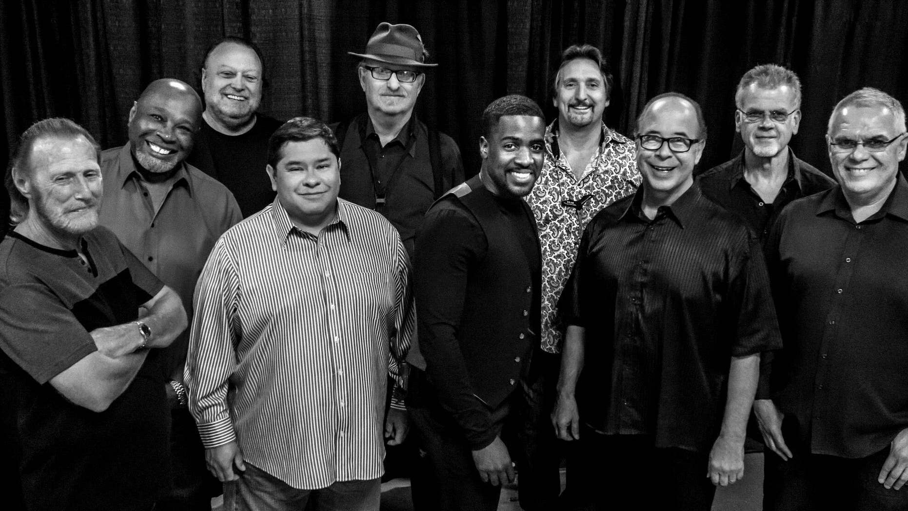 """This Aug. 2016 photo provided by courtesy of Tower of Power/Webster Public Relations, shows the band members from Tower of Power, from left, Rocco Prestia, Roger Smith, Sal Cracchiolo, Adolfo Acosta, Stephen """"Doc"""" Kupka, Marcus Scott, Tom E. Politzer, Emilio Castillo, David Garibaldi, and Jerry Cortez."""