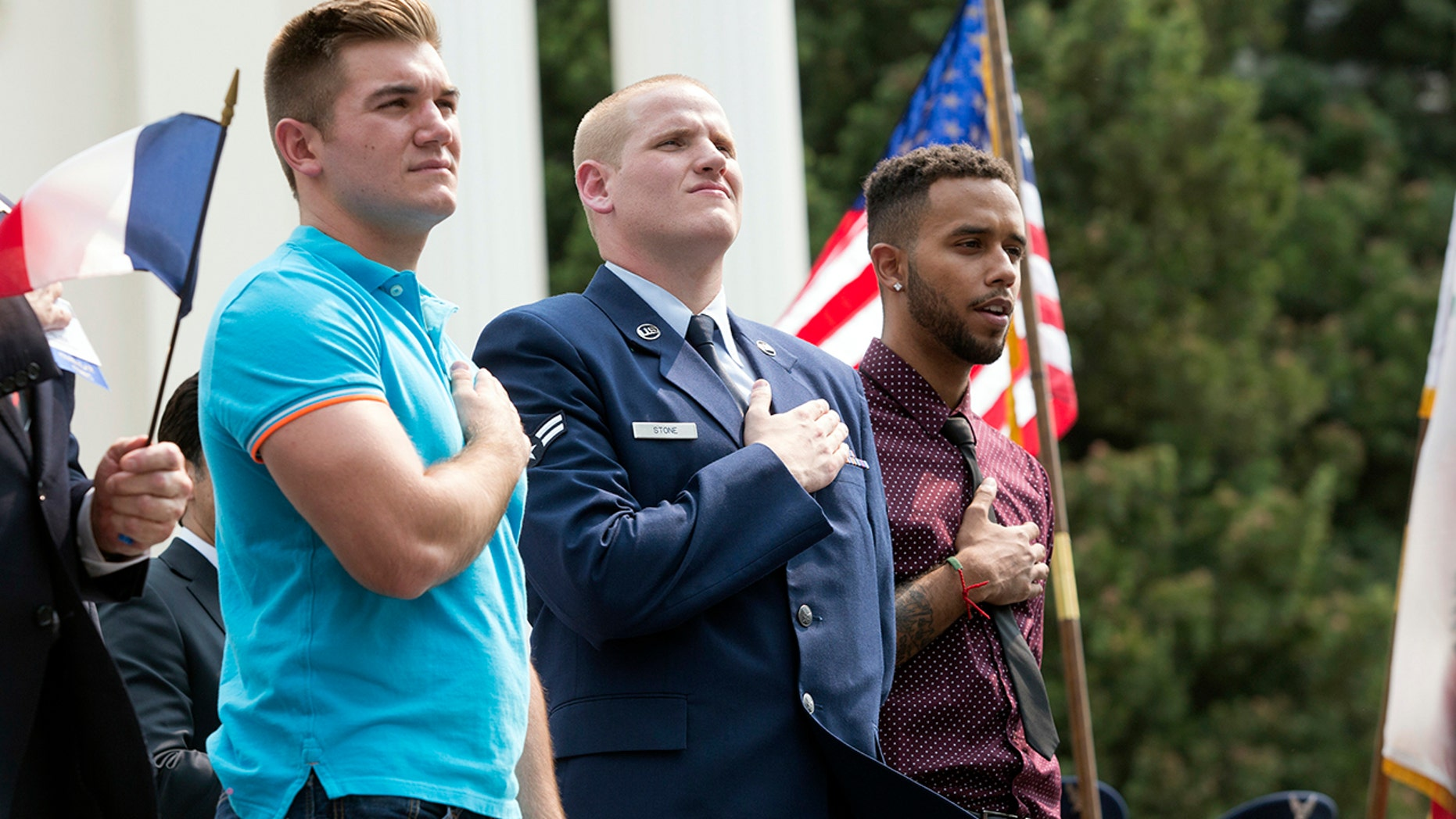 """In this Sept. 11, 2015 file photo, Oregon National Guardsman Alek Skarlatos, left, U.S. Airman Spencer Stone, center, and Anthony Sadler attend a parade held to honor the three Americans who stopped a gunman on a Paris-bound passenger train, in Sacramento, Calif. The three Sacramento-area men who thwarted a terror attack on a French train in 2015 will play themselves in a Clint Eastwood-directed film about their heroic feat. Sadler, Skarlatos, and Stone will star in """"15:17 to Paris,"""" which began production this week."""