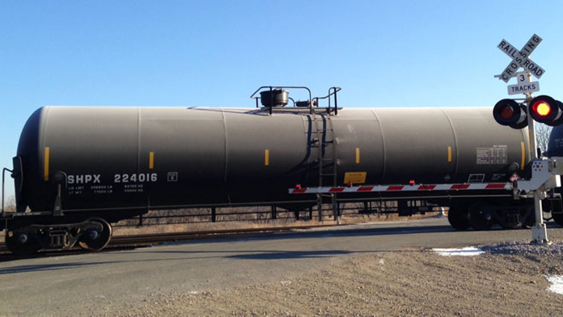 Nov. 14, 2014: A train loaded with oil tank cars idles on a track in North Dakota.