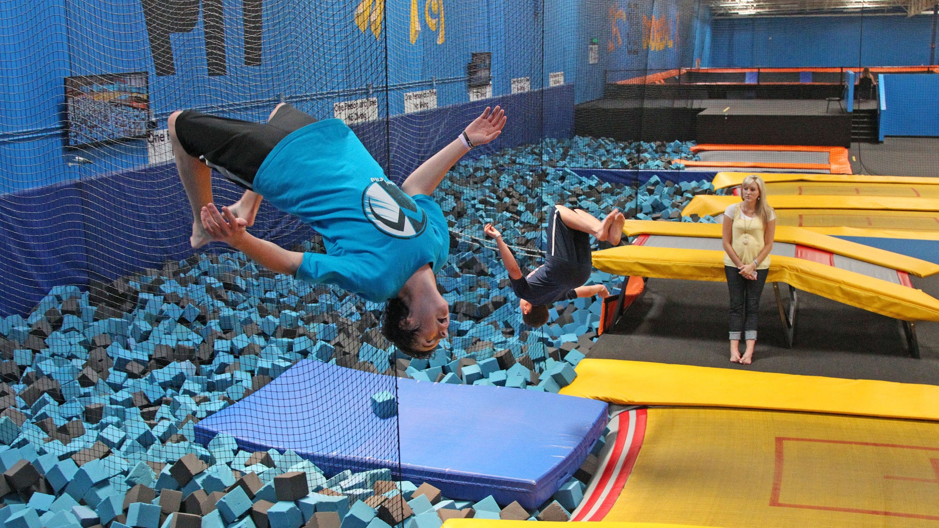 In this July 31, 2013, file photo, a patron flips at a trampoline park in Orem, Utah. Trampoline park injuries have soared as the indoor jumping trend has spread. That's according to a study published Monday, Aug. 1, 2016, that shows annual U.S. emergency room visits jumped 12-fold for park-related injuries from 2010 through 2014. (AP Photo/Rick Bowmer, File)