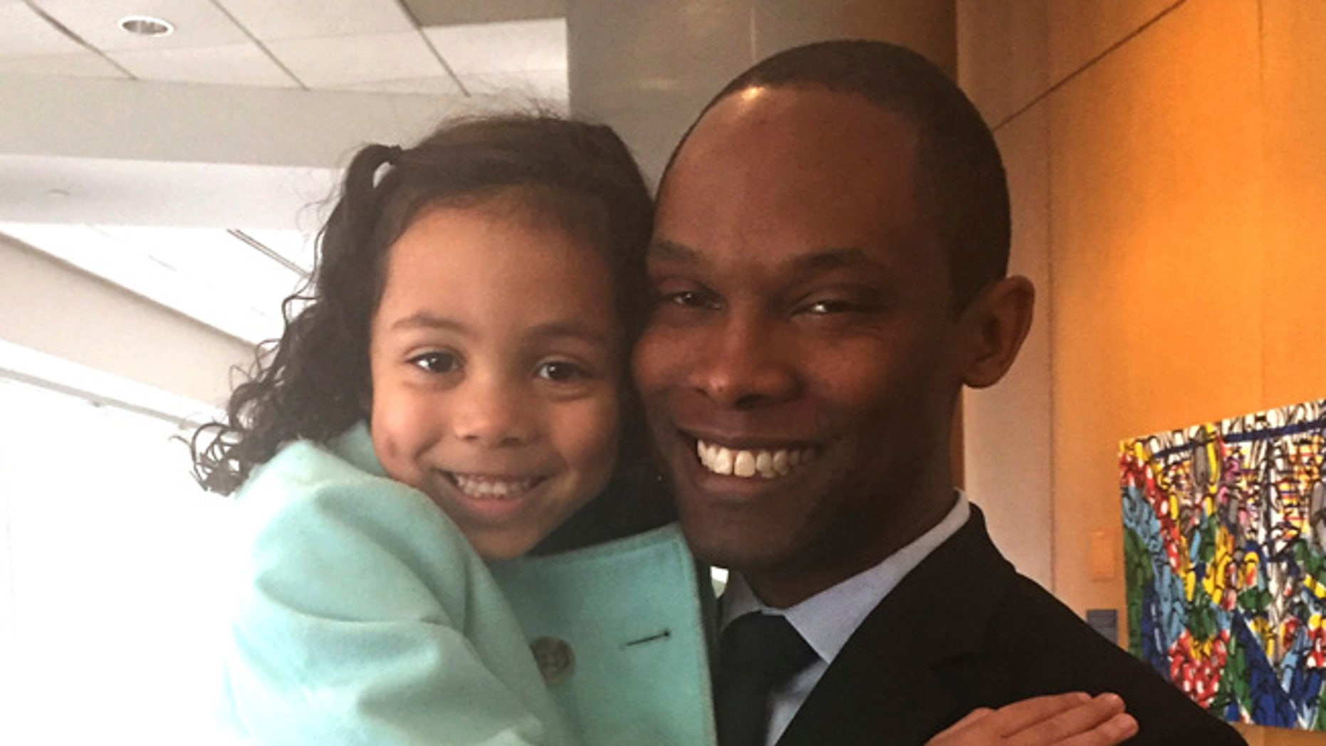 Ellie Ford, 5, is seen with her father, JR Ford, before their meeting with Education Secretary Betsy DeVos in Washington. Families of transgender students came away from a meeting with DeVos saying that she was receptive to their concerns.