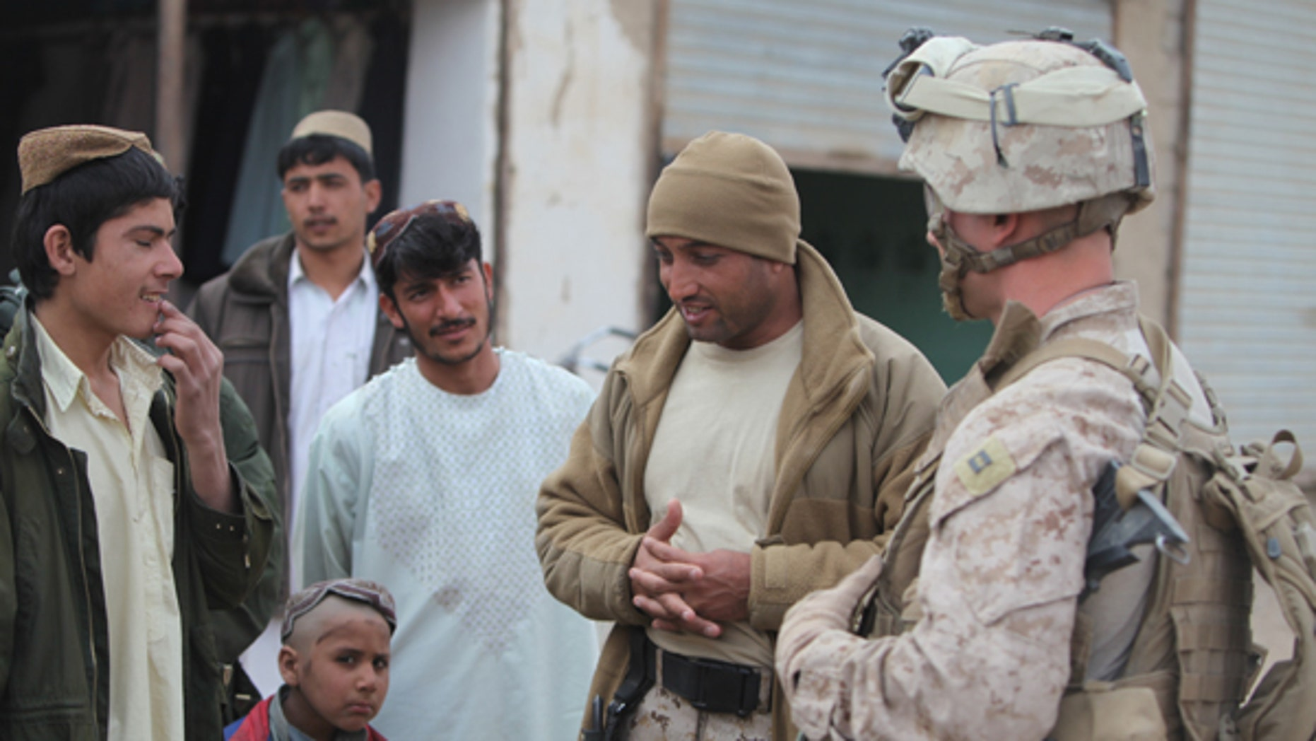 A group of U.S. Marines are fighting for their Afghan interpreter, Zia, pictured second from right, to obtain a Special Immigrant Visa to enter the U.S.